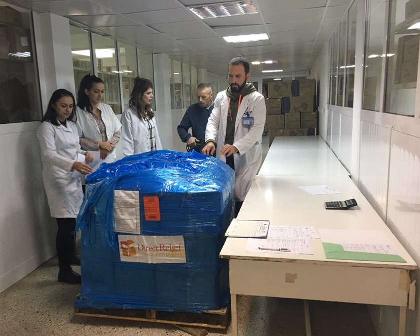 Hospital staff at the University Clinic Center of Kosovo open a shipment of supplies that will help mothers and babies. Over $150,000 worth of supplies, including basic antibiotics, were included in the shipment.