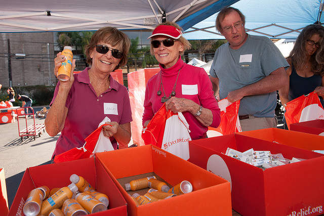 Volunteers assemble Personal Care Packs. Photo by Jay Farbman.