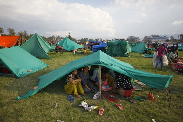 Survivors of the Nepal earthquake take shelter.