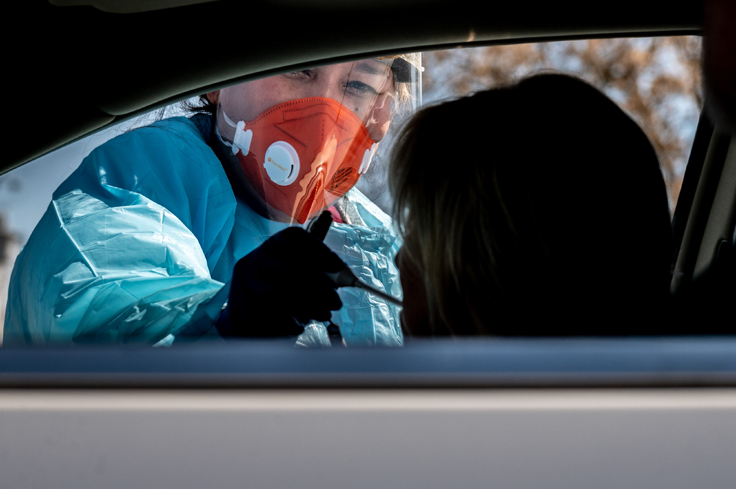 Staff with Ampla Health Care conduct Covid-19 testing at a drive-through site in Yuba City, California, on Friday, March 27, 2020. The site was provided with protective gear from Direct Relief. (Photo by Renée C. Byer/ZUMA Wire)