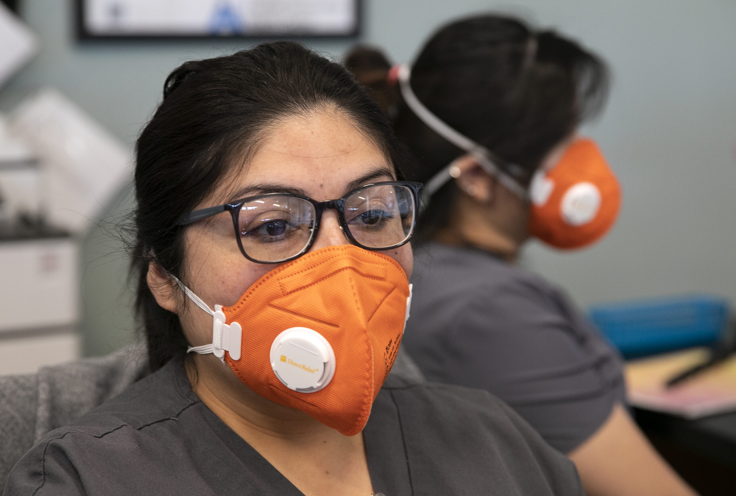 San Jose, California, United States: Health Workers wear N95 masks while manning the front desk at the Foothill Community Health Center during the coronavirus outbreak. (LiPo Ching / San Francisco Chronicle / Polaris)