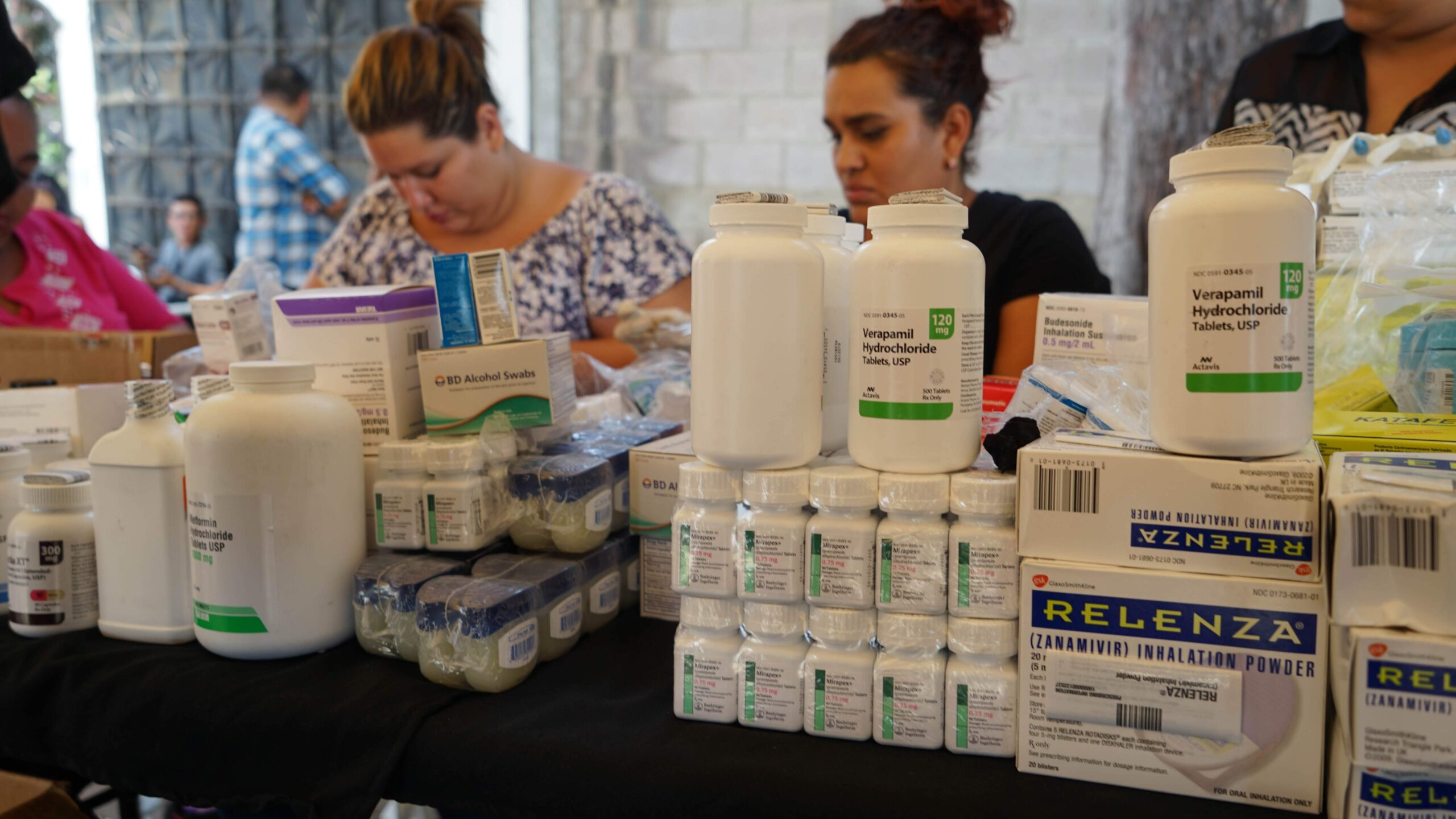 Direct Relief-donated medicines are distributed to volunteer health professionals serving patients during a community health event in San Sebastian de Saltillo, Santa Ana, El Salvador in February 2019. The event was hosted by the municipality with support from Proemigrant, a local nonprofit that distributes Direct Relief-donated medicines to vulnerable patients across the country. (Greg Mora/Direct Relief)