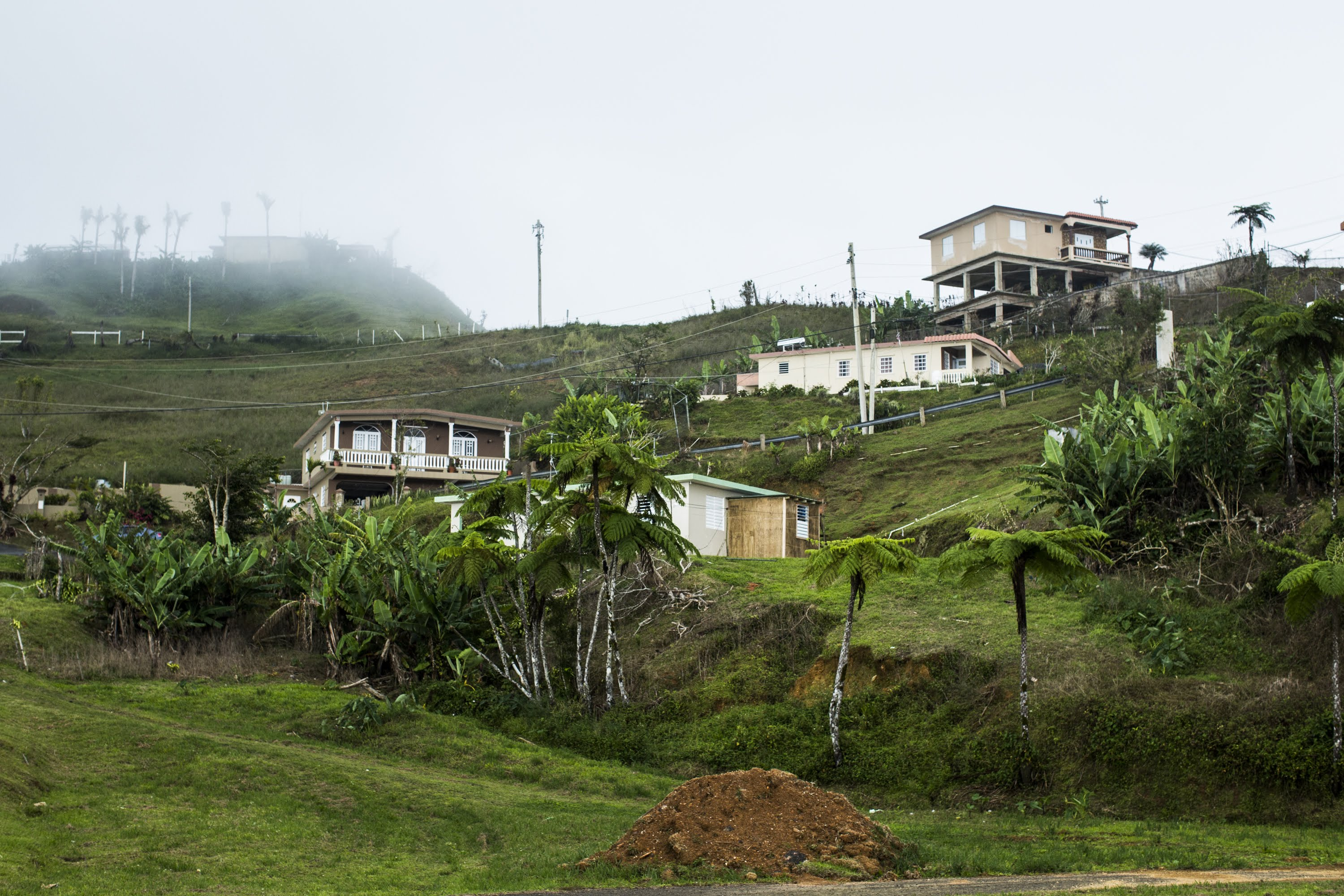 View of Bauta Abajo community in Orocovis, P.R., on April 5, 2018. The mountain top community  has been without power since hurricane Irma hit the island 7 months ago, leaving the 300 families without a reliable water source.  Por Los Nuestros, a local non-profit that was created in response to hurricane Maria's aftermath, has been working in the community to donate the installation and equipment to energize and store solar power for their potable water system. Months after the storm the water pumps were being powered by a gas power generator, that could only provide intermittent water of the residents. With funds from Direct Relief two solar power systems could be completed for their two water pumps. (Erika P. Rodríguez for Direct Relief)