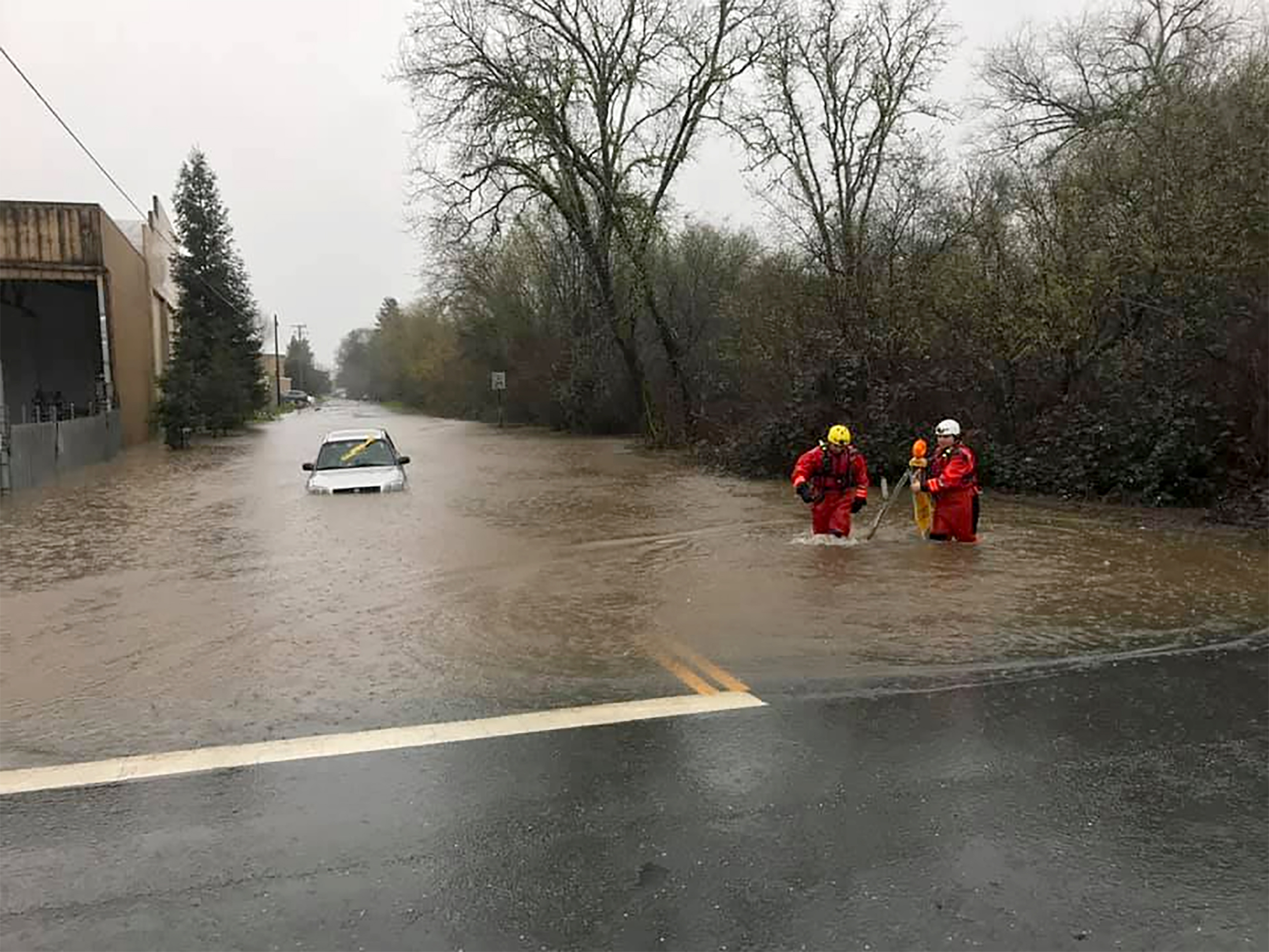 Emergency personnel wade through flood waters in Sonoma County on Feb. 26, 2019. (Photo courtesy of the Sonoma County Sheriff's Office)