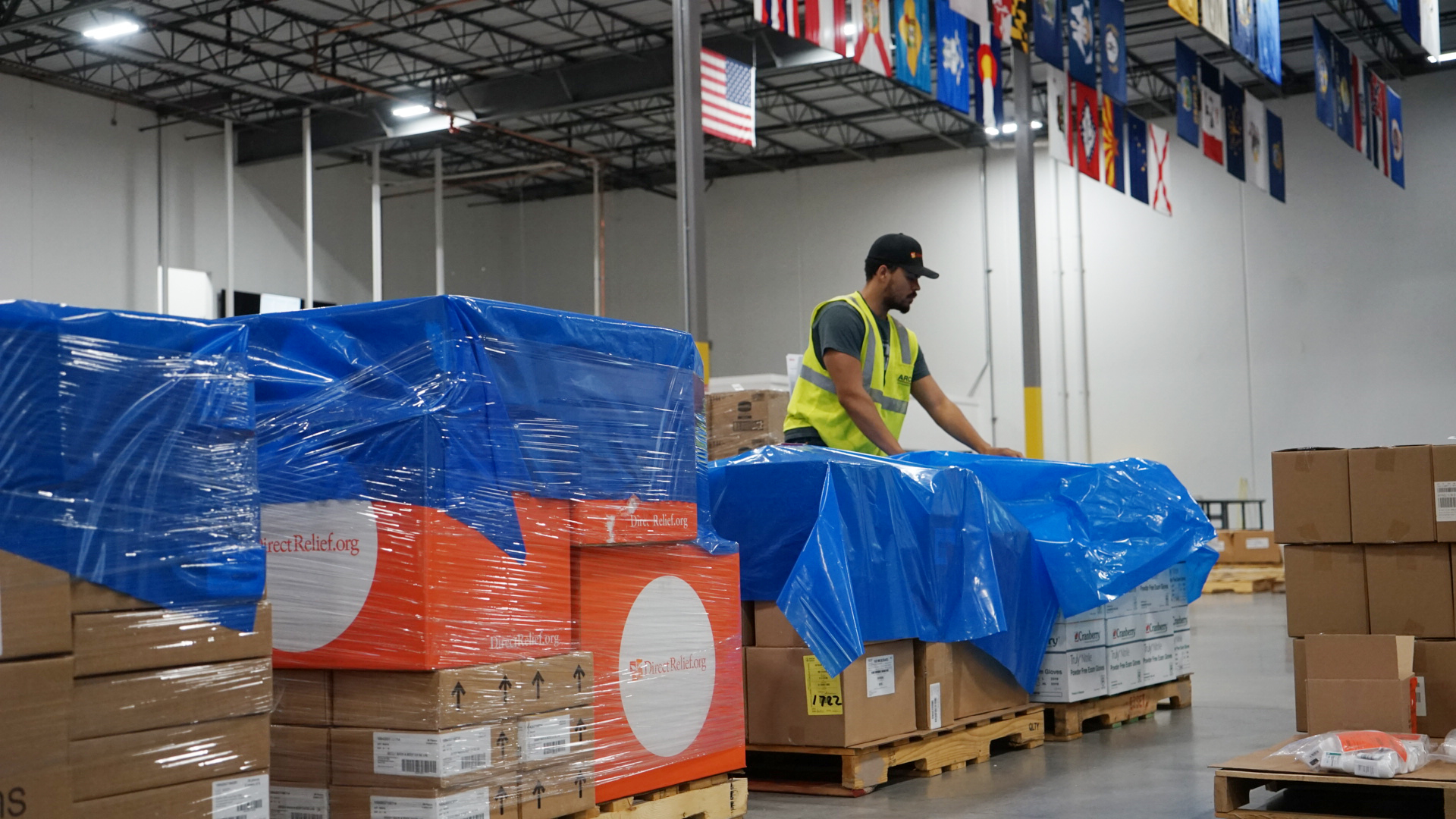Medical aid and protective gear was packaged for transport from Direct Relief's warehouse in August 2018, bound for the Democratic Republic of Congo. Since the country's outbreak of Ebola began last August, Direct Relief has shipped more than $8.5 million in medical aid to health facilities providing health care in the country. (Bryn Blanks/Direct Relief)