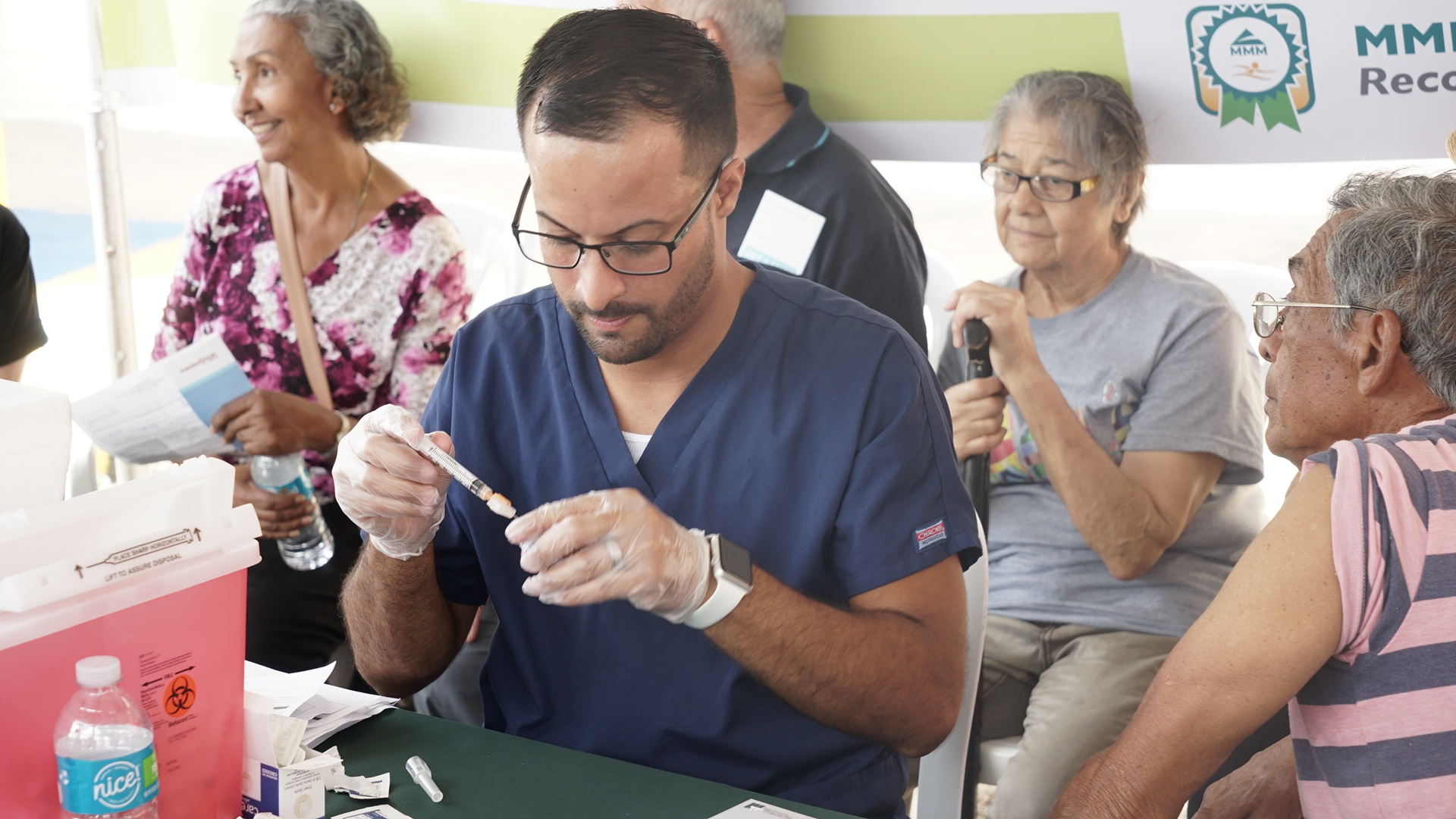 A flu immunization campaign takes place in Bayamon, Puerto Rico, in March, 2018. Direct Relief has supported vaccination efforts across the island, and is now expanding capacity for cold storage of immunizations and other medications. (Tony Morain/Direct Relief)