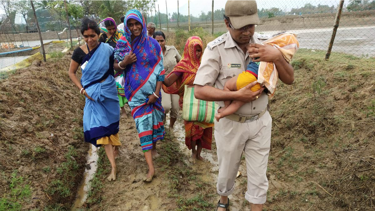 Families evacuate in Odisha, India, before Cyclone Fani came ashore on Friday. (Photo courtesy of Odisha Police Department)