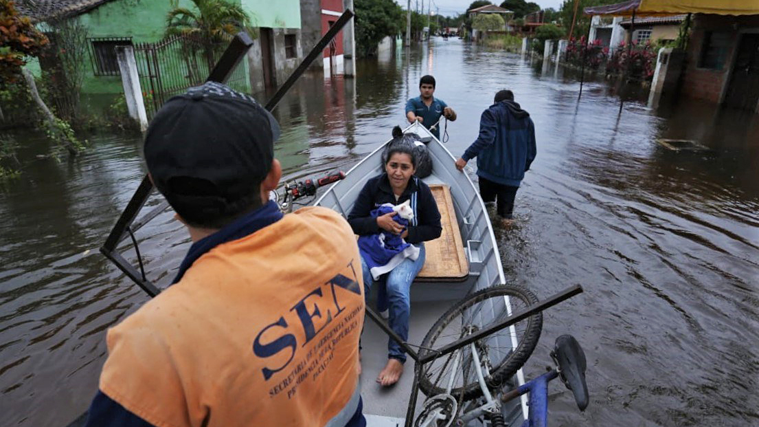 Flooding has inundated communities across Paraguay after seasonal rains swept through the region. Direct Relief is working with agencies responding, including Paraguay's Ministry of Health, to coordinate shipments of requested medical aid. Here, emergency responders help residents evacuate. (Photo courtesy of Paraguay's Secretariat of National Emergency)