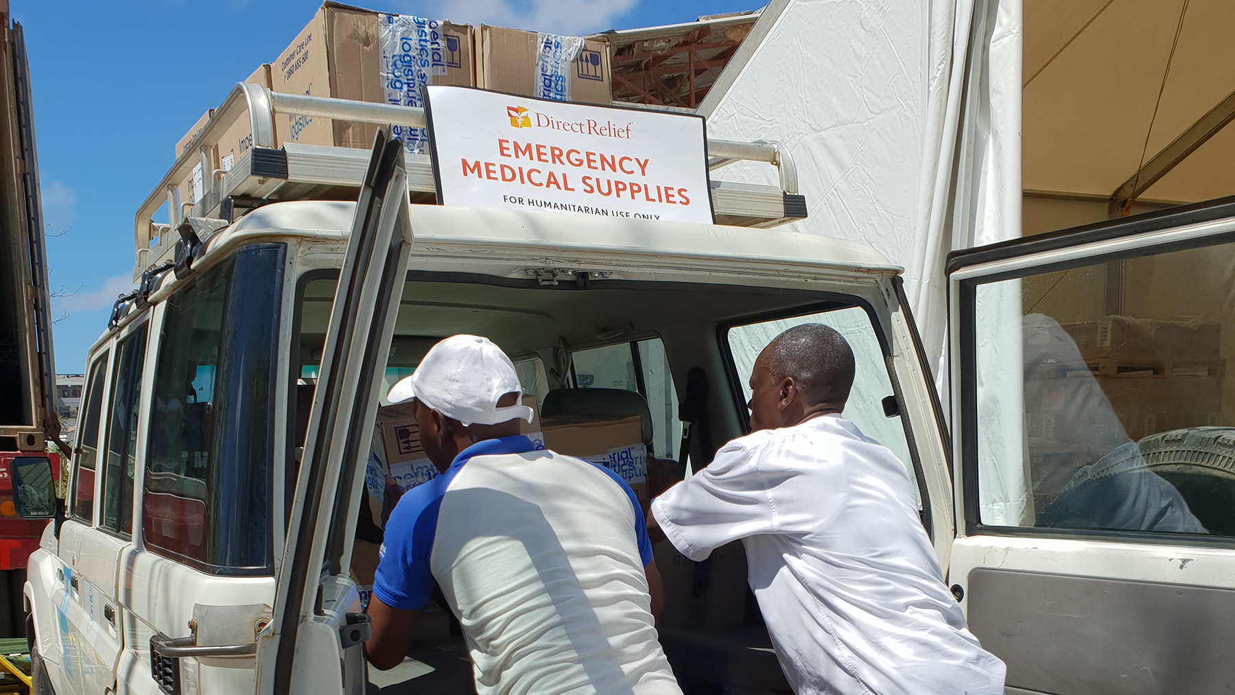 Medical staff from Health Alliance International unload medical supplies from Direct Relief at temporary clinics in Mozambique in April, 2019. Direct Relief has been supporting the work of local groups in Mozambique as they work to treat patients still impacted by the two cyclones that swept through the country earlier this year. (Photo courtesy of Health Alliance International)
