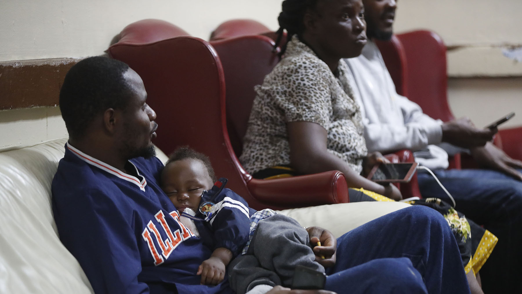 Nearly 100 Congolese asylum seekers released from the U.S. southern border arrived in mid-June at Vive Shelter, operated by Jericho Road Health Center in Buffalo, New York. The health center and shelter have been working to meet health needs of new arrivals. Here, shelter residents rest at Vive Shelter on June 17, 2019.  (Mark Mulville/Buffalo News)