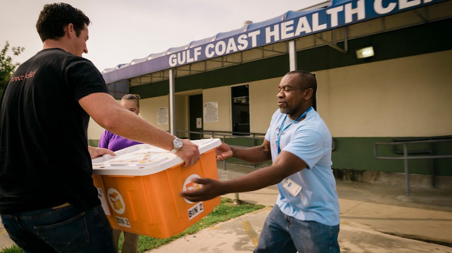 Direct Relief staff deliver medical aid to Gulf Coast Health Center in Port Arthur, Texas in response to Hurricane Harvey. Access to vital medicine is often jeopardized after a hurricane. (Photo by Bimarian Films for Direct Relief)