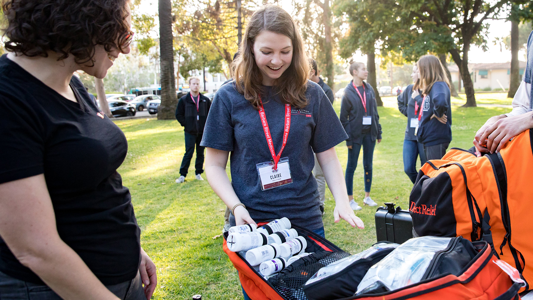 Doctors Without Walls volunteer Claire Sharp inventories the contents of an Emergency Medical Pack before coordinating outreach with patients, most of whom lack permanent housing. The packs are supplied by Direct Relief, then customized with frequently needed prescription medications. (Photo by Mark Semegen for Direct Relief)