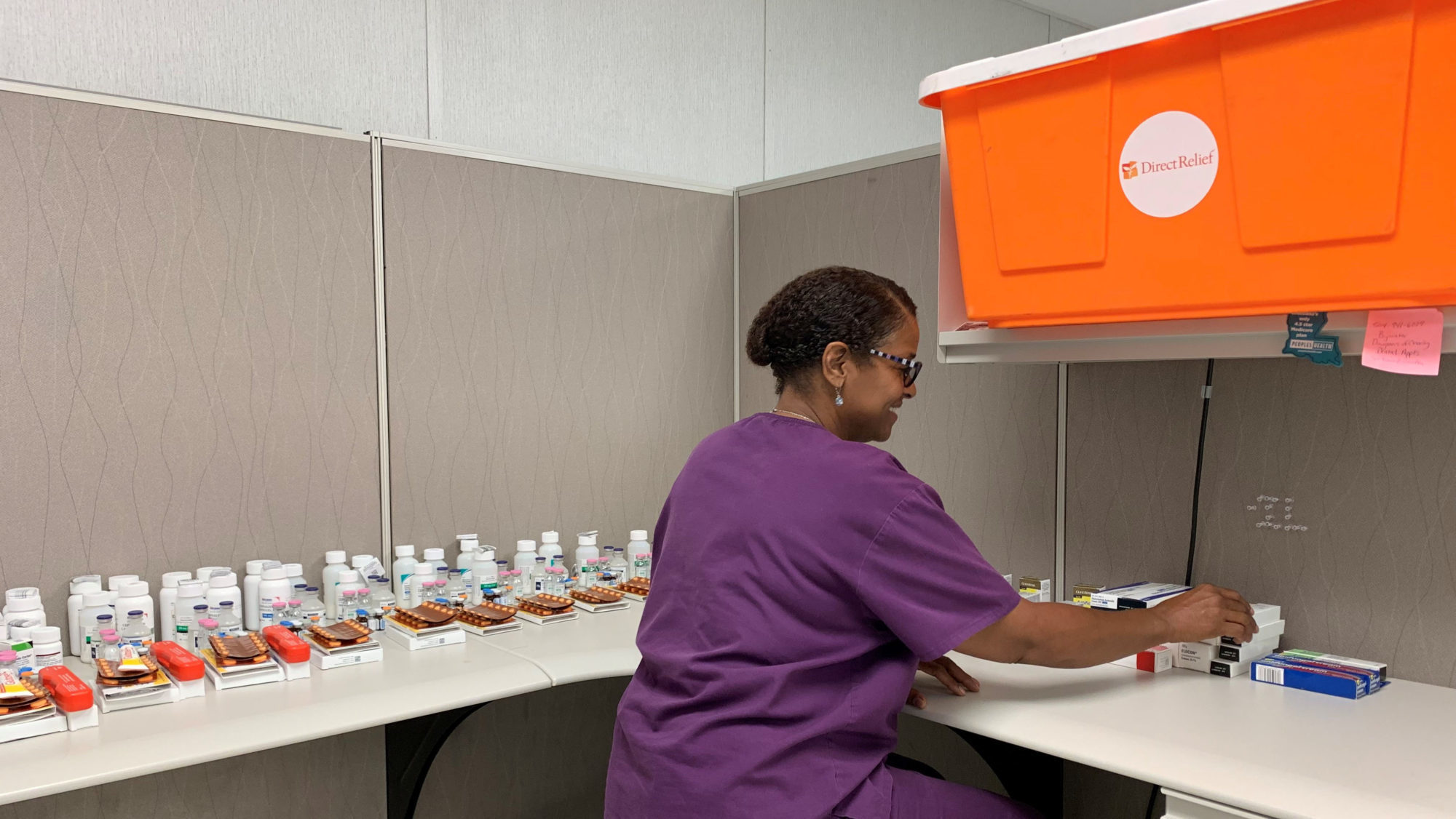 A staff member at Baptist Community Health Services sorts the contents of a Direct Relief Hurricane Prep Pack. Packs were placed at strategic locations across Louisiana in preparation for extreme weather. (Photo courtesy of Baptist Community Health Services)