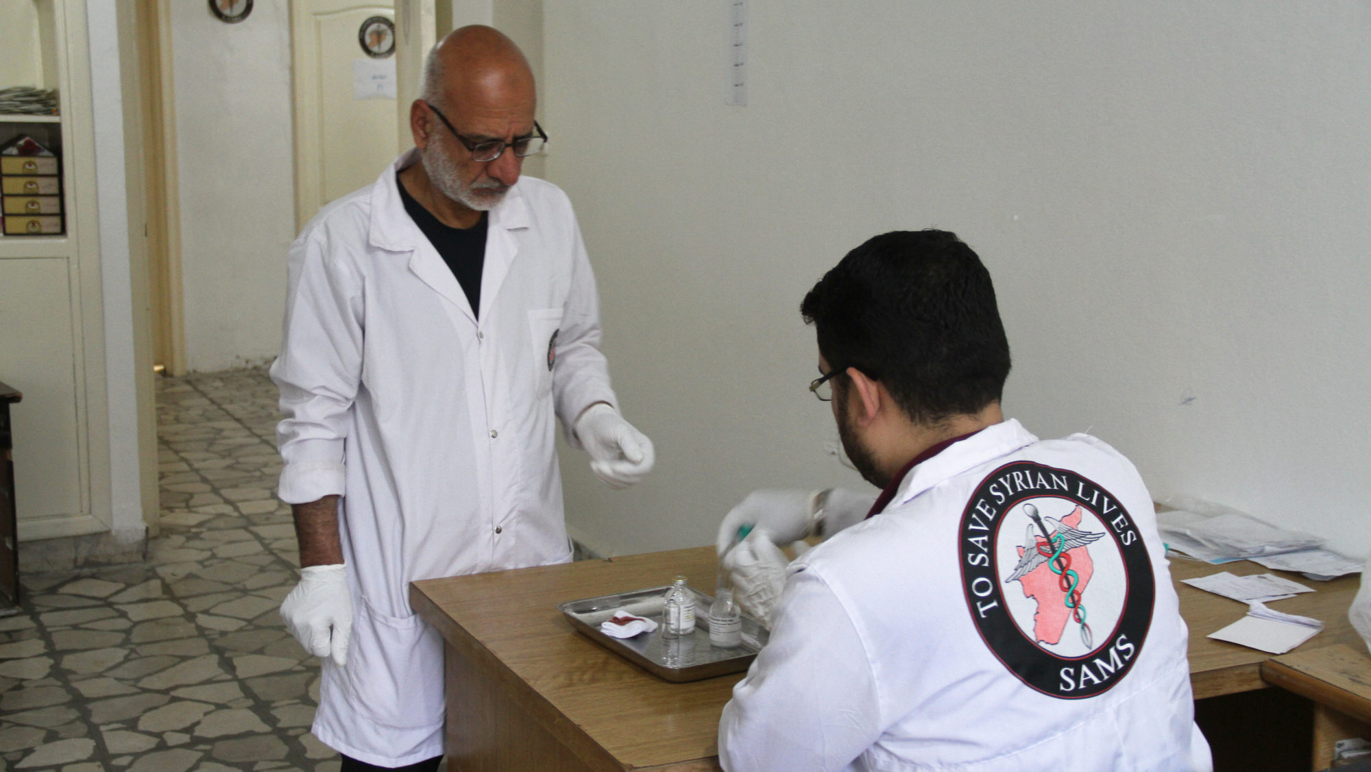 Medical staff prepare medication at the SAMS Oncology Center in Idlib, Syria. The facility is filling a gap for patients that would otherwise have to travel long distances for cancer care, or forgo treatment altogether. (Photo courtesy of SAMS)