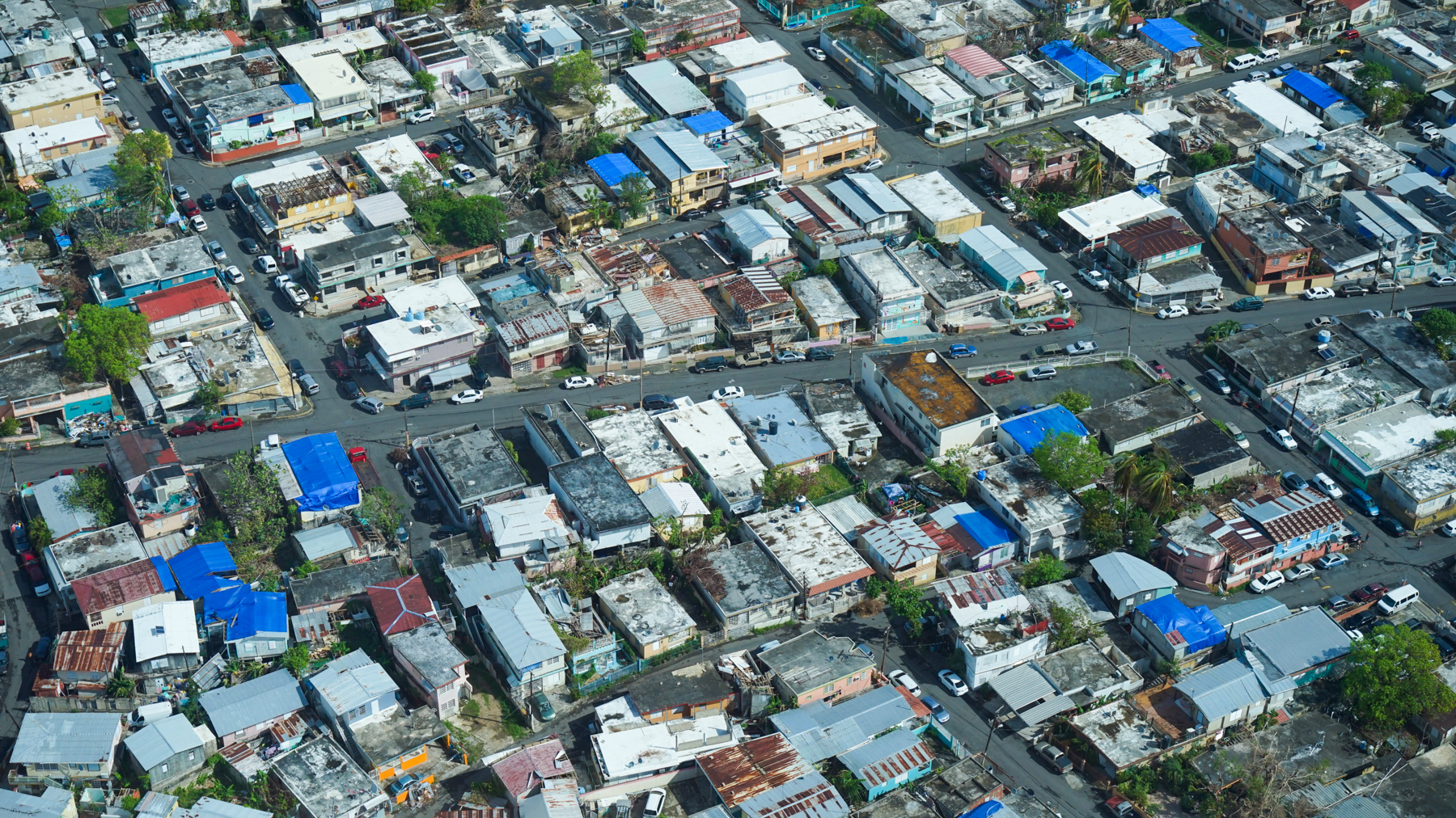 Homes with missing roofs after Hurricane Maria in 2017. With new mapping technology, humanitarian organizations are able to determine who is most vulnerable in an emergency and where to direct aid. (Lara Cooper/Direct Relief)