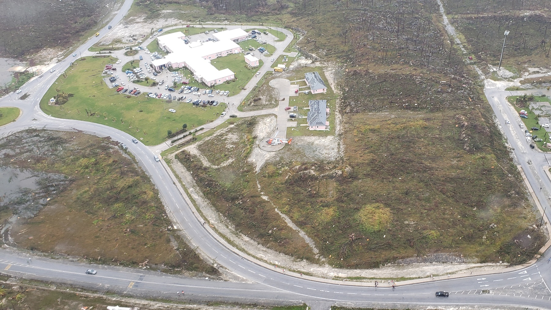 An aerial photograph of the clinic at Marsh Harbor, Grand Abaco, surrounded by damage caused by Hurricane Dorian. (Photo courtesy of the U.S. Coast Guard)