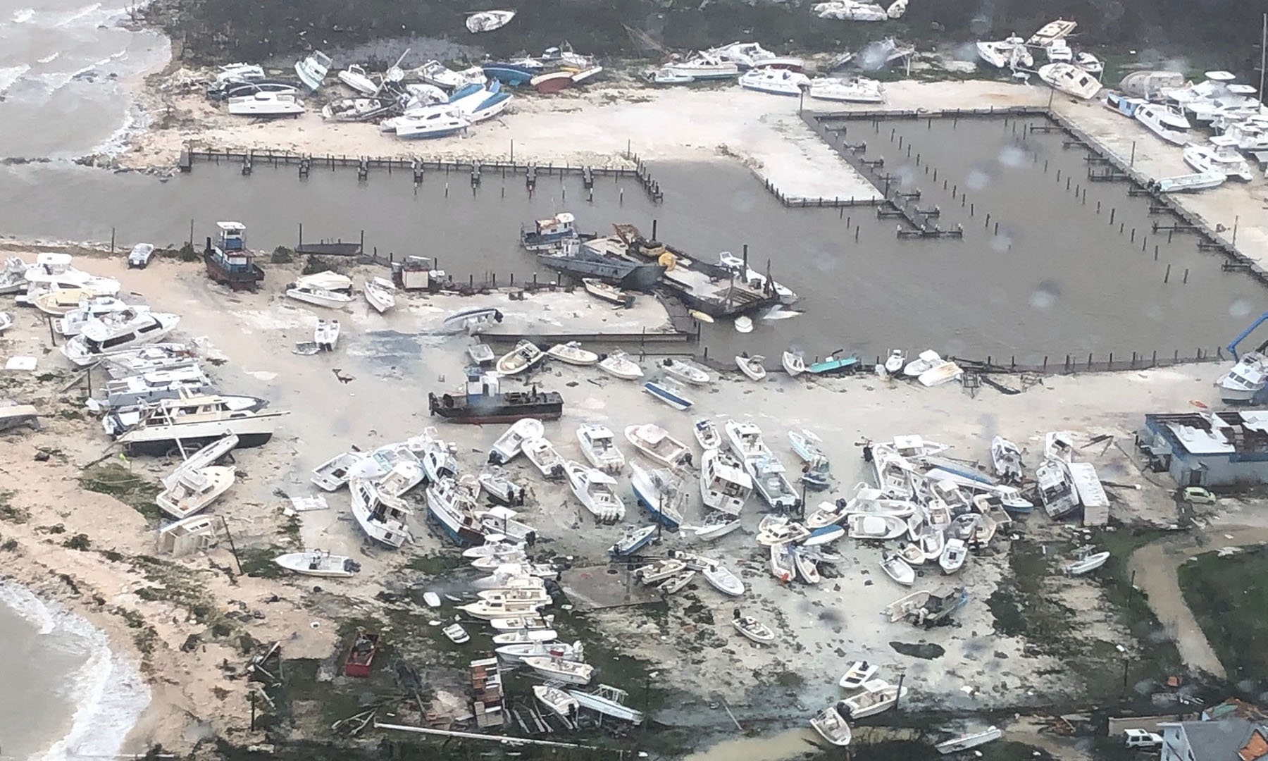 A hurricane-damaged marina in the Bahamas is seen from the air on Sept. 2, 2019, and search and rescue efforts are underway across the islands. (Photo by Coast Guard Air Station Clearwater)