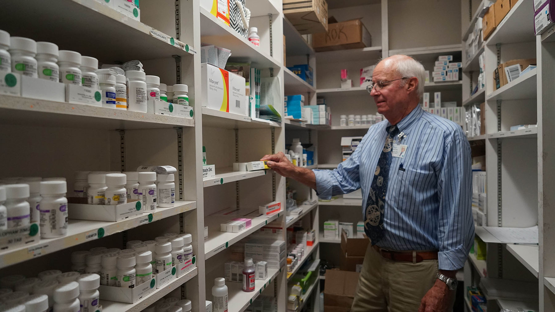 Dr. Chuck Fenzi inventories medicines at the Westside Neighborhood Clinic. Since 2017, Direct Relief has provided health centers, clinics, and organizations across the country with over 350,000 vials of Naloxone, including the Santa Barbara Neighborhood Clinics. (Amarica Rafanelli/Direct Relief)