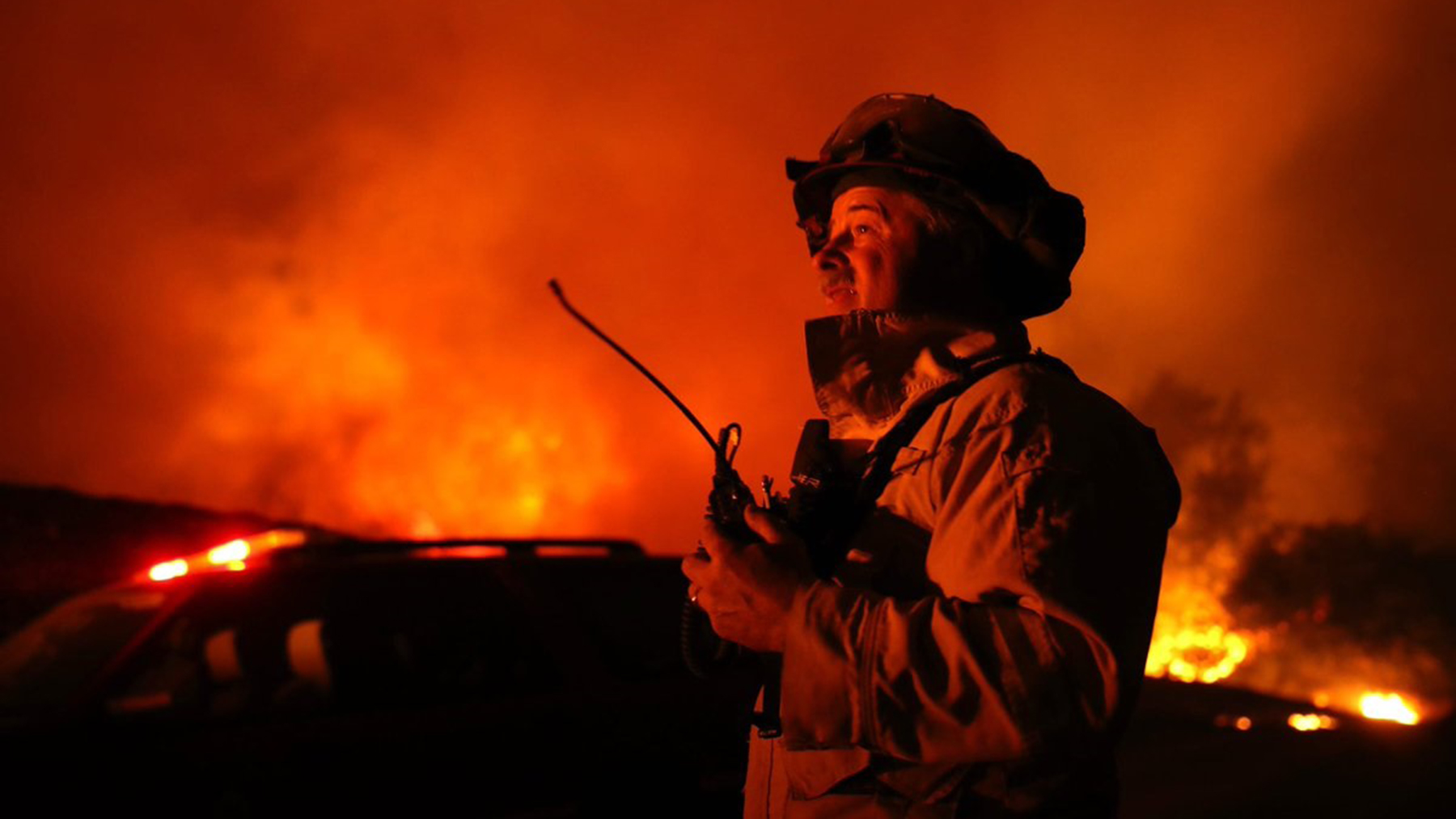 A firefighter, part of CAL FIRE's response to the Kincade Fire, takes in the blaze. (Photo courtesy of CAL FIRE San Luis Obispo)