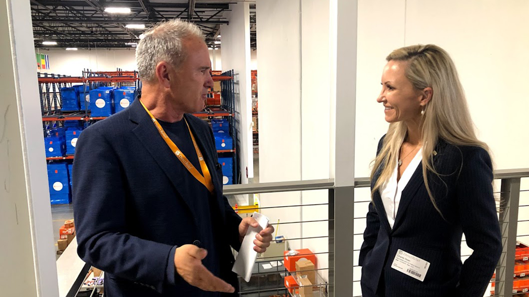 Dr. Charity Dean in conversation with Thomas Tighe, Direct Relief's president and CEO, in the organization's medical warehouse on November 12, 2019. (Tony Morain/Direct Relief)