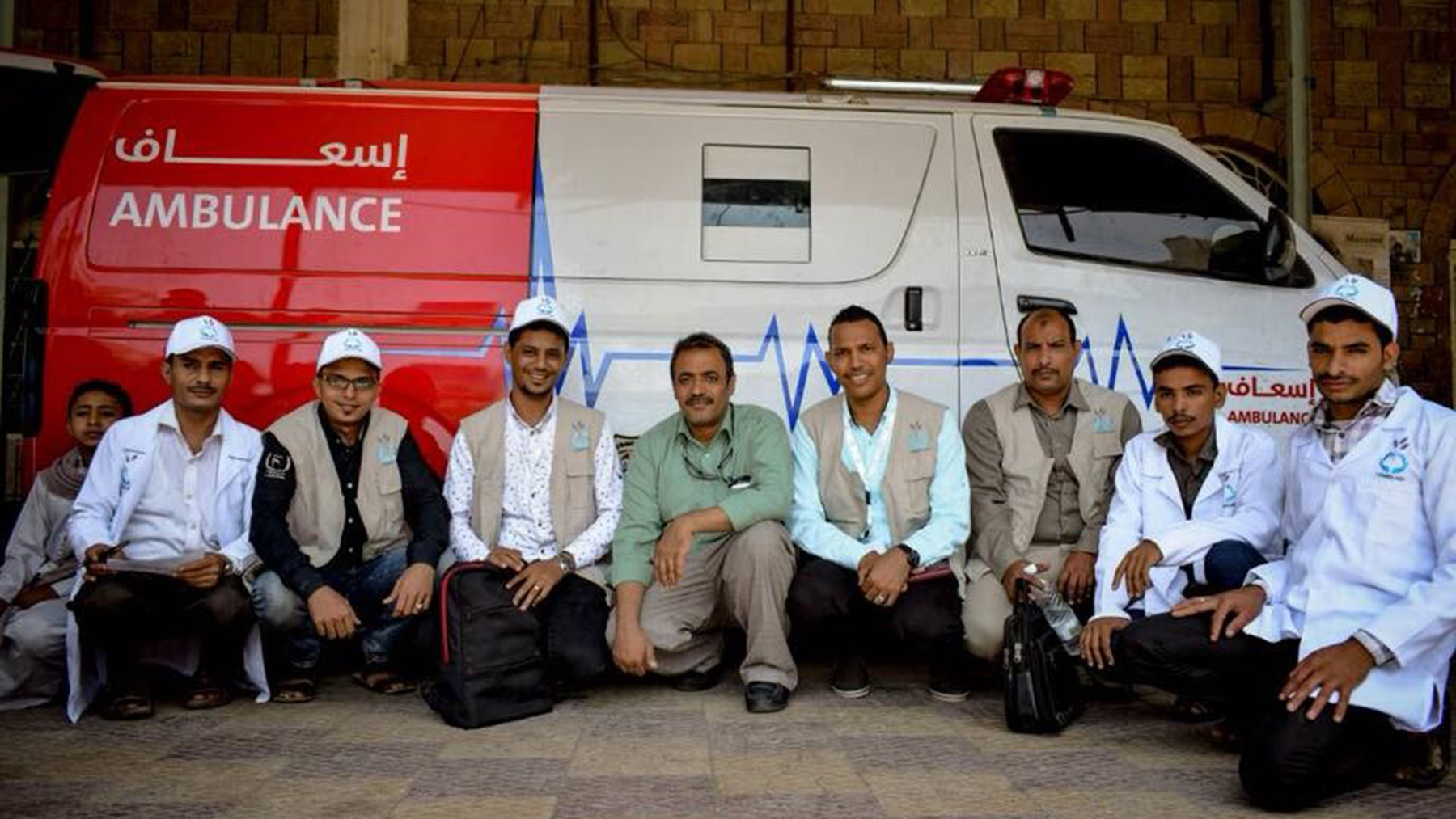First responders pose outside of an ambulance in Hodeidah. (Photo courtesy of Yemen Aid)