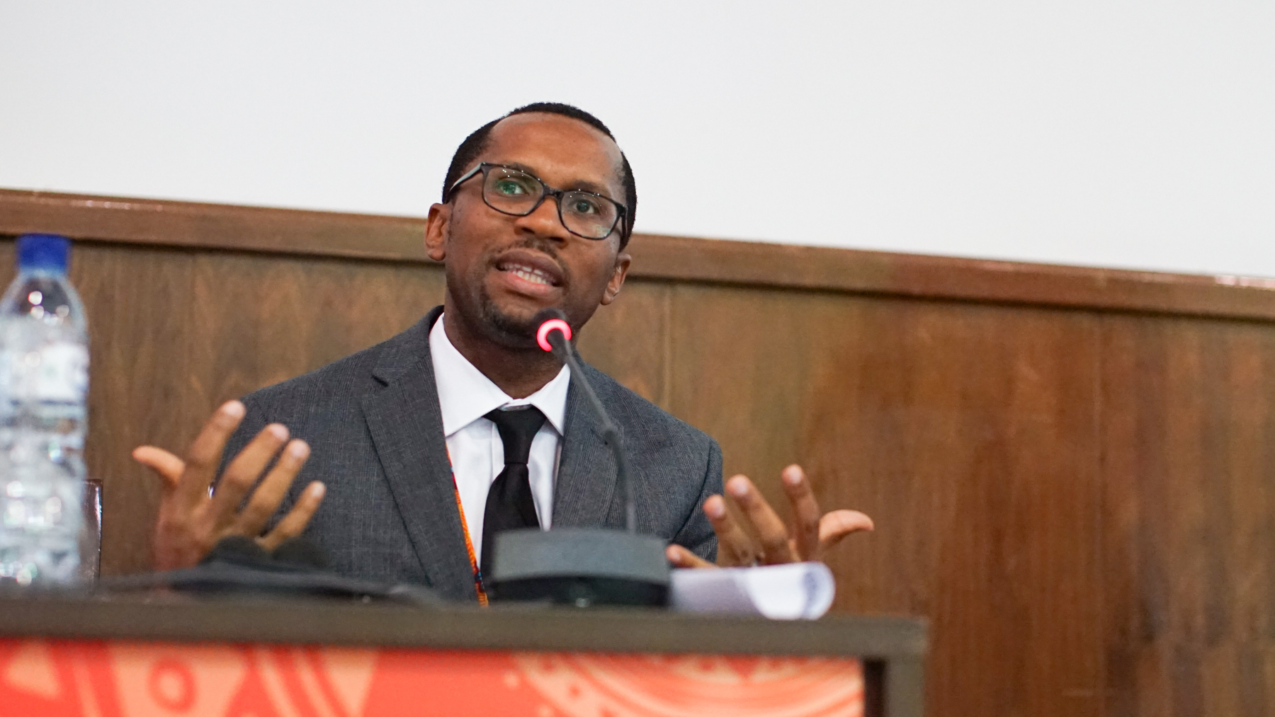 "Dr. Nmazuo ""Maz"" Ozuah speaks on a panel at the AORTIC Conference in Maputo, Mozambique in 2019. Ozuah is working with Global Hope with the goal of treating 4,000 new pediatric cancer patients in Malawi over the next five years. Expanding access to cancer treatment in Botswana and Uganda is also a goal of the collaboration."