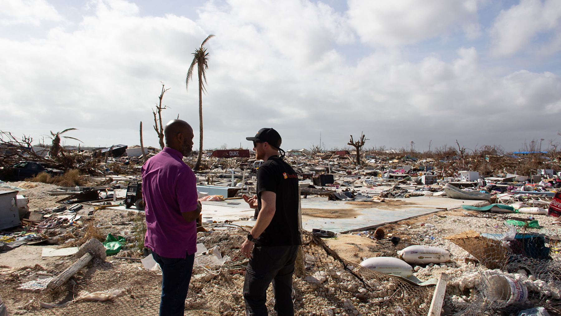 Direct Relief's Gordon Wilcock meets with a doctor in the Bahamas after Hurricane Dorian hit the islands as a Category 5 hurricane in August.