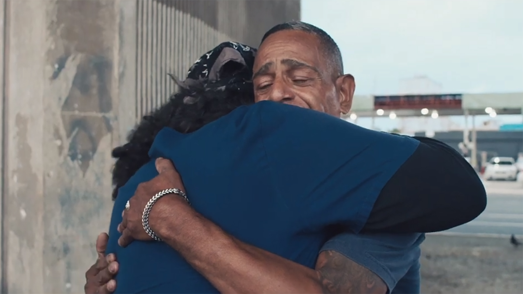 Dr. Chaco Vargas hugs a patient in Puerto Rico while doing outreach earlier this year. Vargas and many other health providers are working to connect those in recovery from opioid addiction with services and resources as many of them continue to rebuild their lives after Hurricane Maria. (Bimarian Films)
