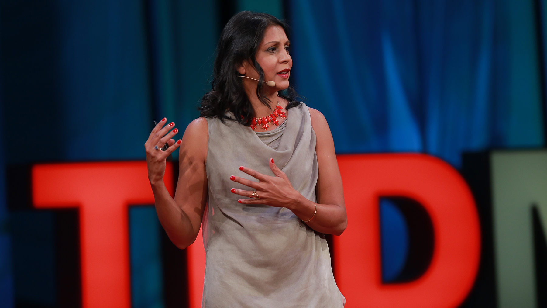 Sonia Shah delivering a TEDMED talk. (Photo courtesy of Sonia Shah)