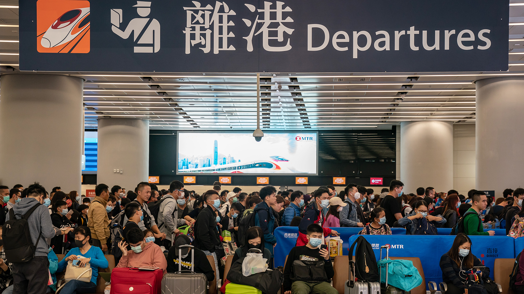 Travelers wearing face masks wait at the departure hall of West Kowloon Station on January 23, 2020, in Hong Kong, China. Hong Kong reported its first two cases of Wuhan coronavirus infections as the number of those who have died from the virus in China climbed to seventeen on Wednesday and cases have been reported in other countries including the United States,Thailand, Japan, Taiwan and South Korea. (Photo by Anthony Kwan/Getty Images)