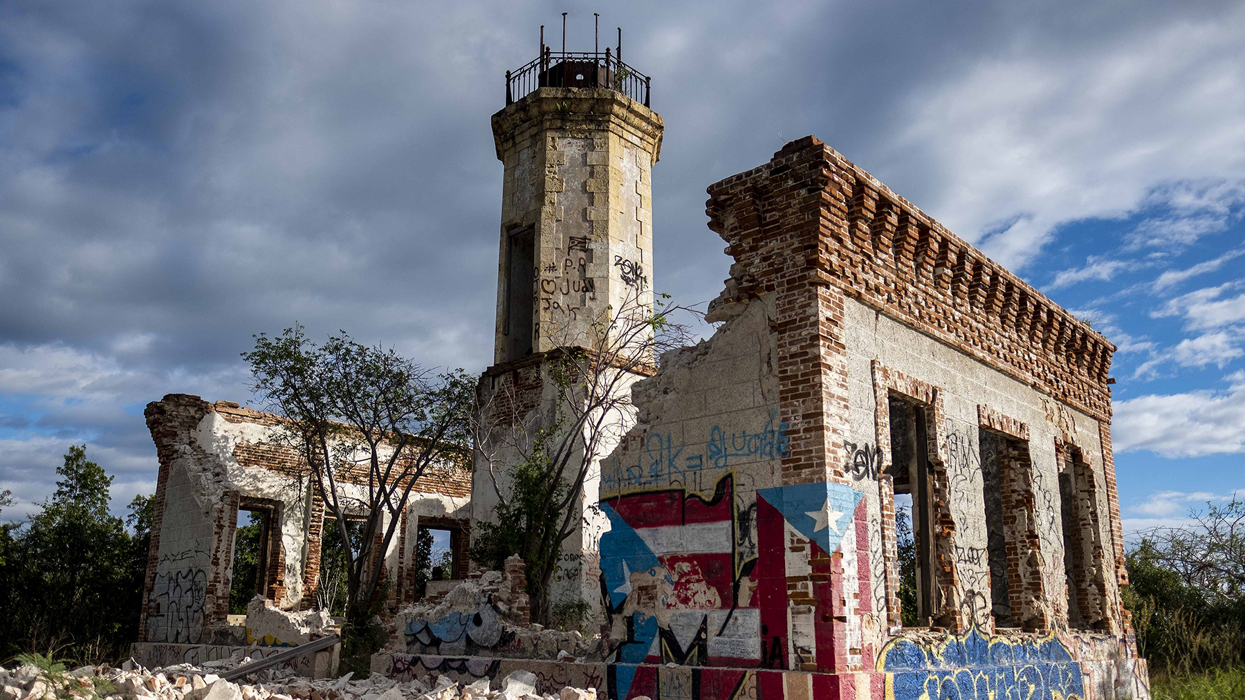 The collapsed wall of the ruins of an iconic landmark lighthouse is seen in Guanica, Puerto Rico on January 6, 2020, after it was destroyed by an earthquake. (Photo by RICARDO ARDUENGO/AFP via Getty Images)