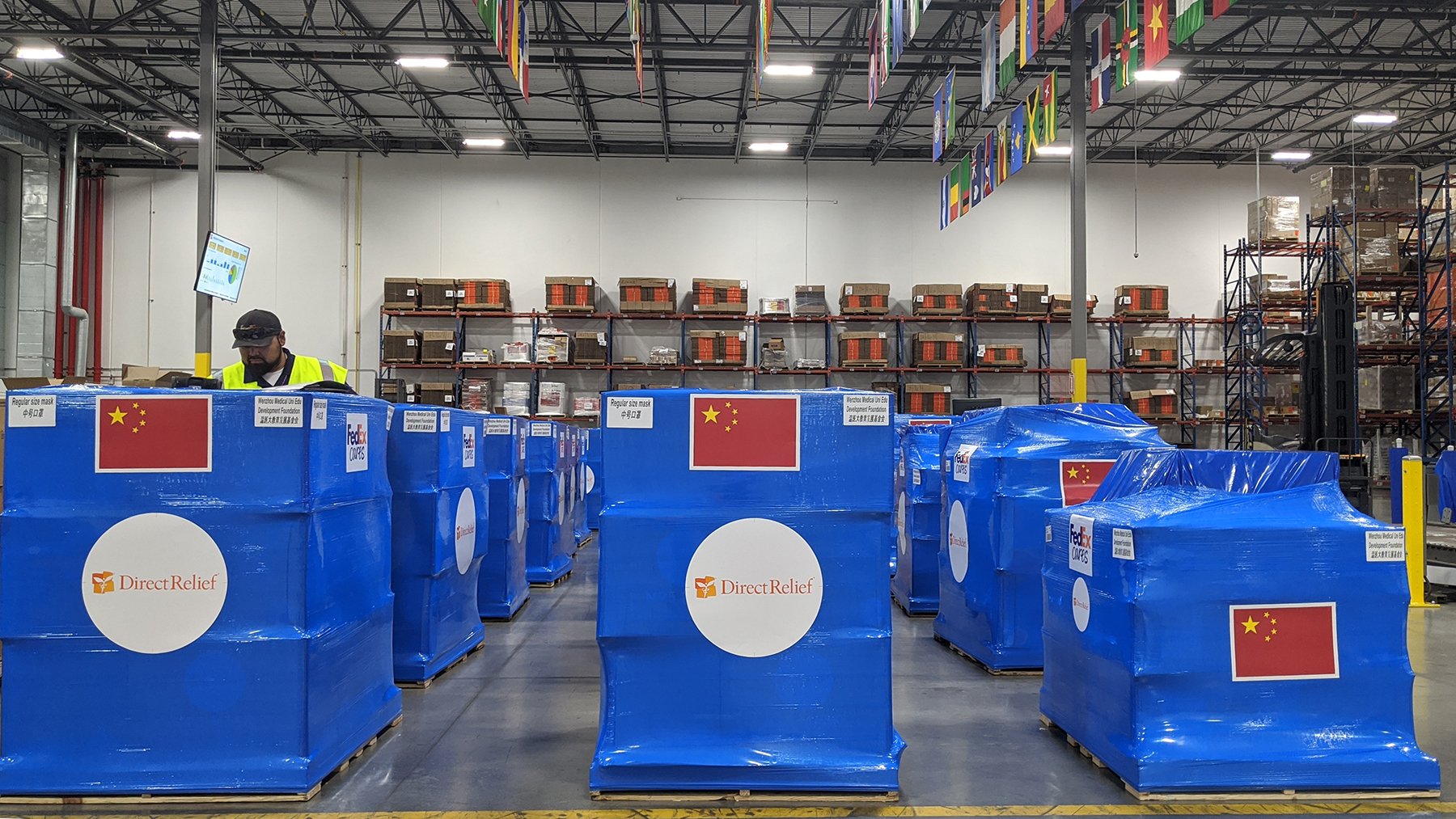 Protective gear destined for Wenzhou, China, leaves Direct Relief's warehouse in February. The organization committed an additional $2 million for response efforts. (Tony Morain/Direct Relief)