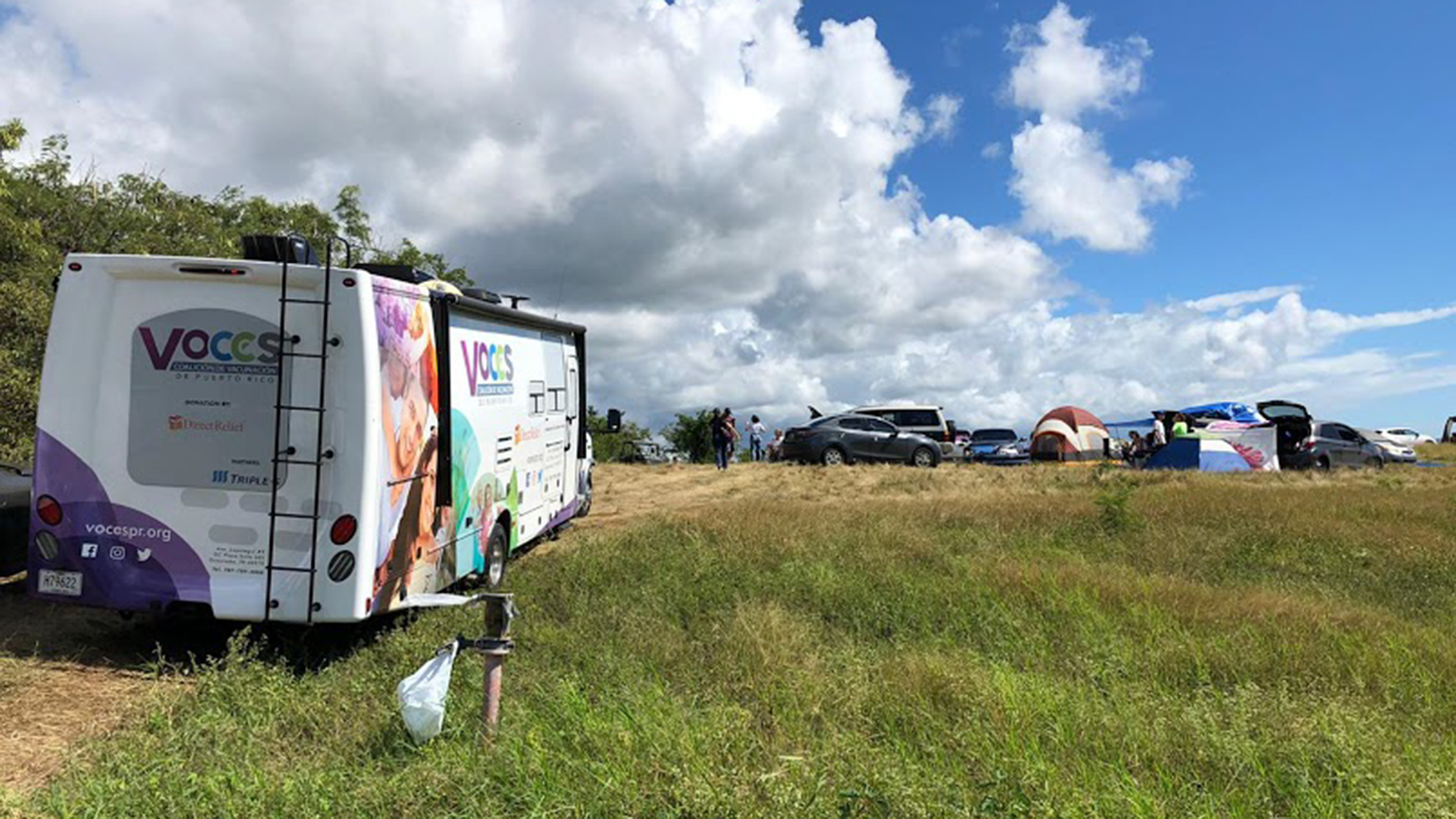 A mobile clinic from the organization VOCES positioned at the Los Indios camp in Guayanilla, Puerto Rico. Evacuees lived at the camp for more than two weeks, working together and receiving care at a mobile health outpost organized by Direct Relief. (Direct Relief photo)