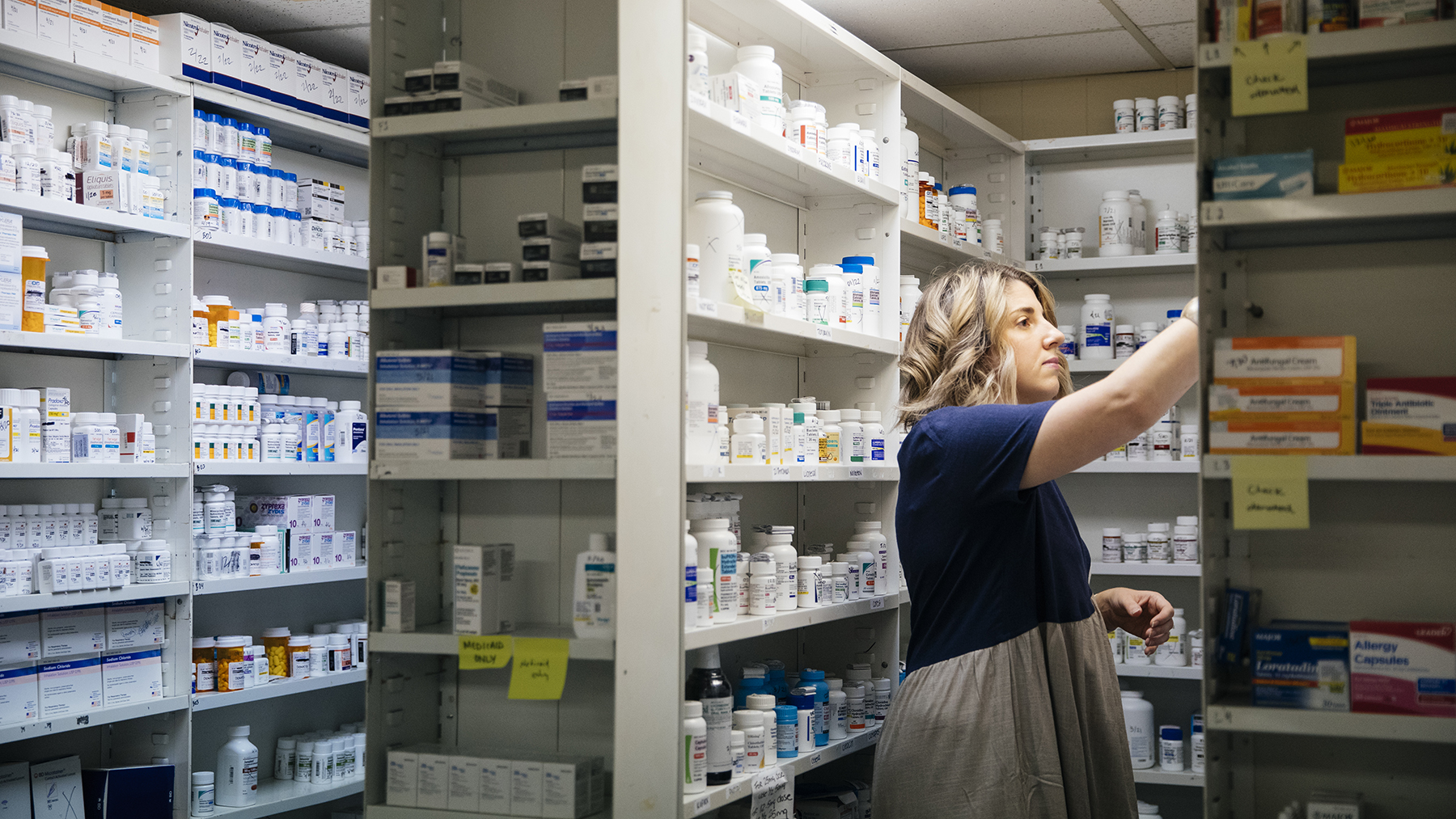 Pharmacist Brooke Kendall stocks medicines at Cape Fear Clinic in Wilmington, North Carolina, in October 2019. Free clinics, like Cape Fear Clinic, serve patients that find it difficult to access care by other means. (Photo by Donnie Hedden for Direct Relief)