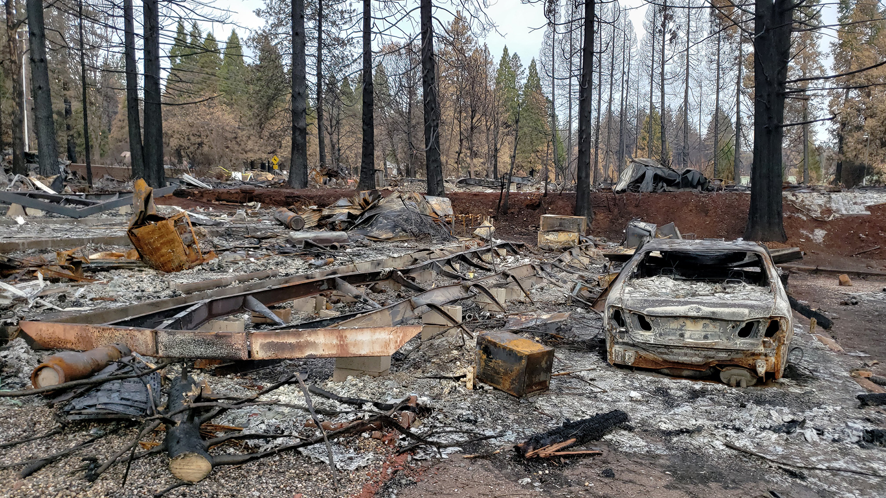 Damage from the Camp Fire, as seen here in Paradise, California, in Dec. 2018, after the fire killed more than 80 people and destroyed most of the Northern California town. Long after they've been extinguished, wildfires can leave behind a toxic mix of chemicals, from melted furniture to incinerated cleaning products to hollowed-out vehicles. (Andrew MacCalla/Direct Relief)