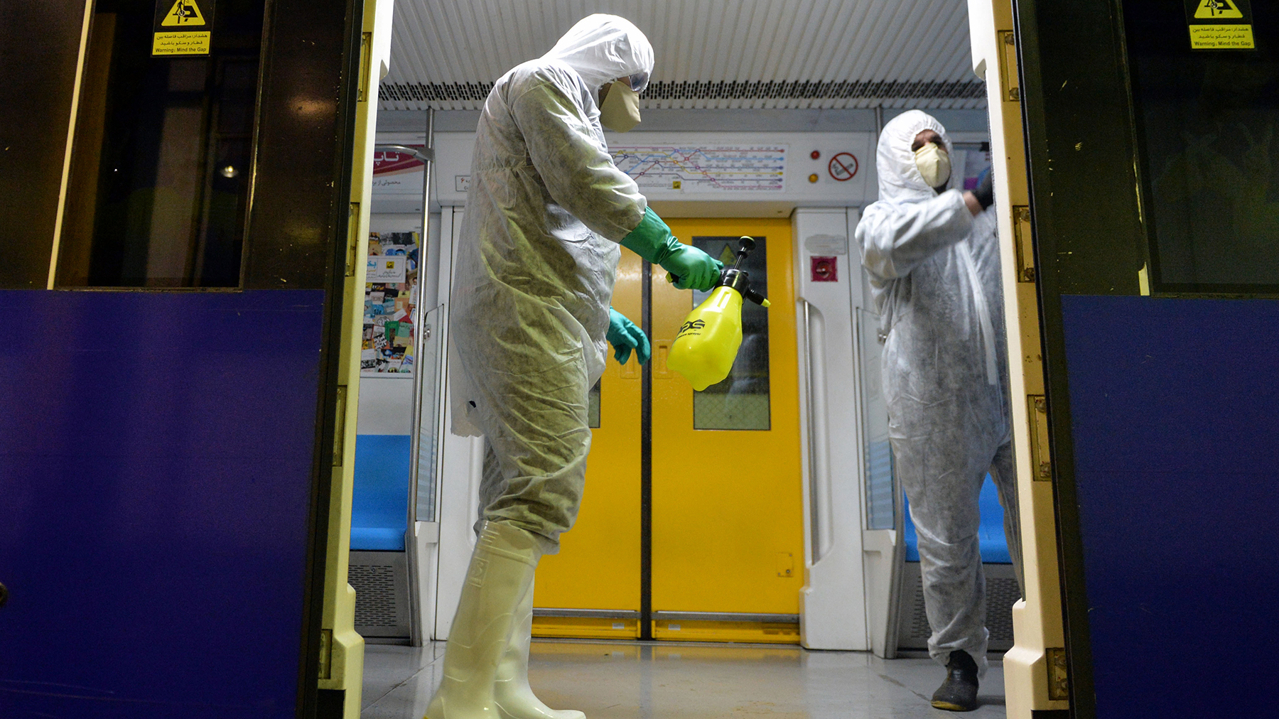 Officials disinfect subway trains to prevent the spread of coronavirus in Tehran, Iran, on February 26, 2020. (Photo by Fatemeh Bahrami/Anadolu Agency via Getty Images)