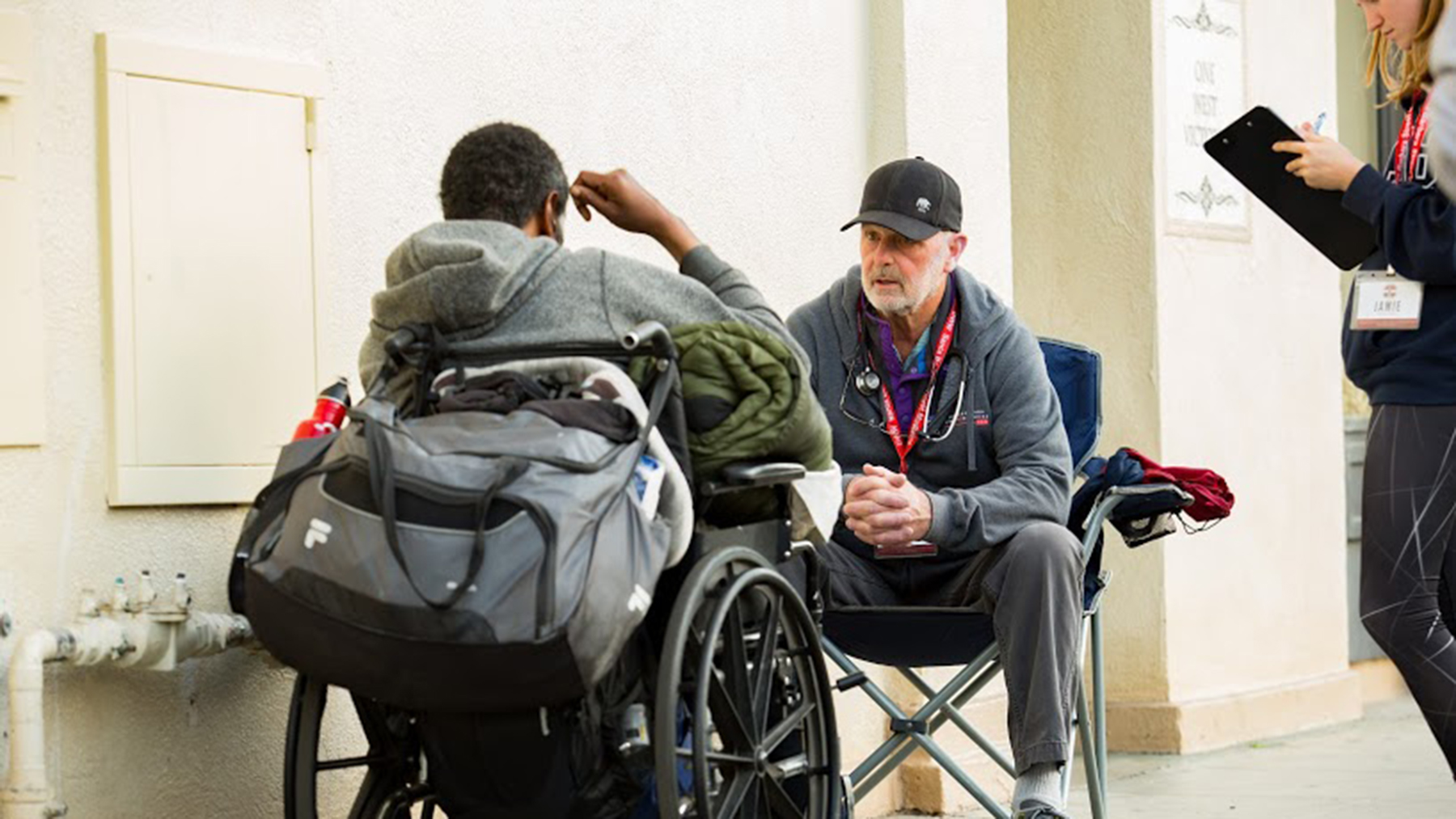 Dr. John Vallee, a volunteer with Doctors Without Walls, in consultation with a homeless patient in 2019. People without permanent housing may be particularly vulnerable to Cobid-19, and health providers are working to protect the population as much as they can. (Photo by Mark Semegen for Direct Relief)
