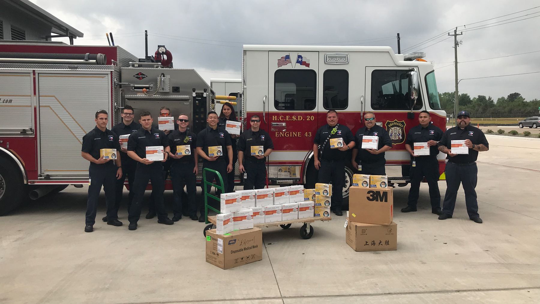 Northwest Volunteer Fire Department (Harris County, Tx.) members in front of a Direct Relief shipment of PPE and supplies. (Photo Courtesy of NWVFD)