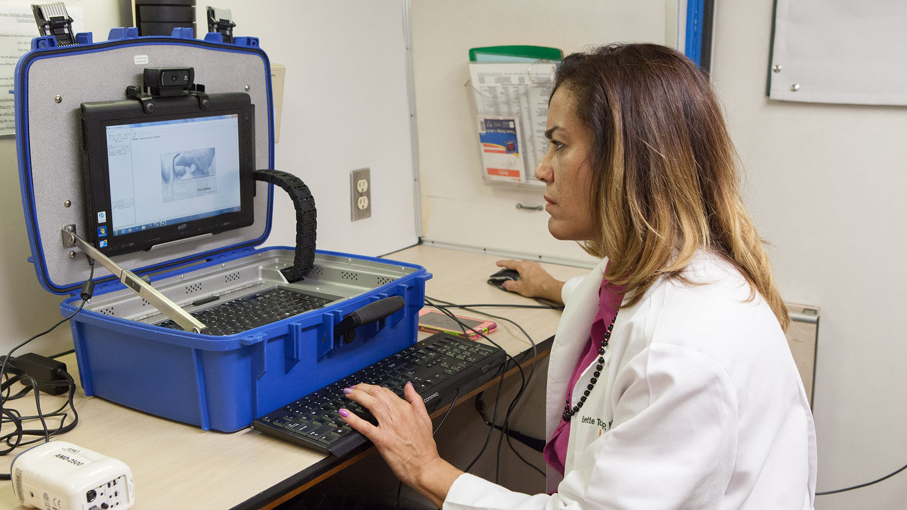 A provider at Florida International University's mobile clinic uses MAVEN Project telehealth services on a computer. (Photo courtesy of the MAVEN Project)