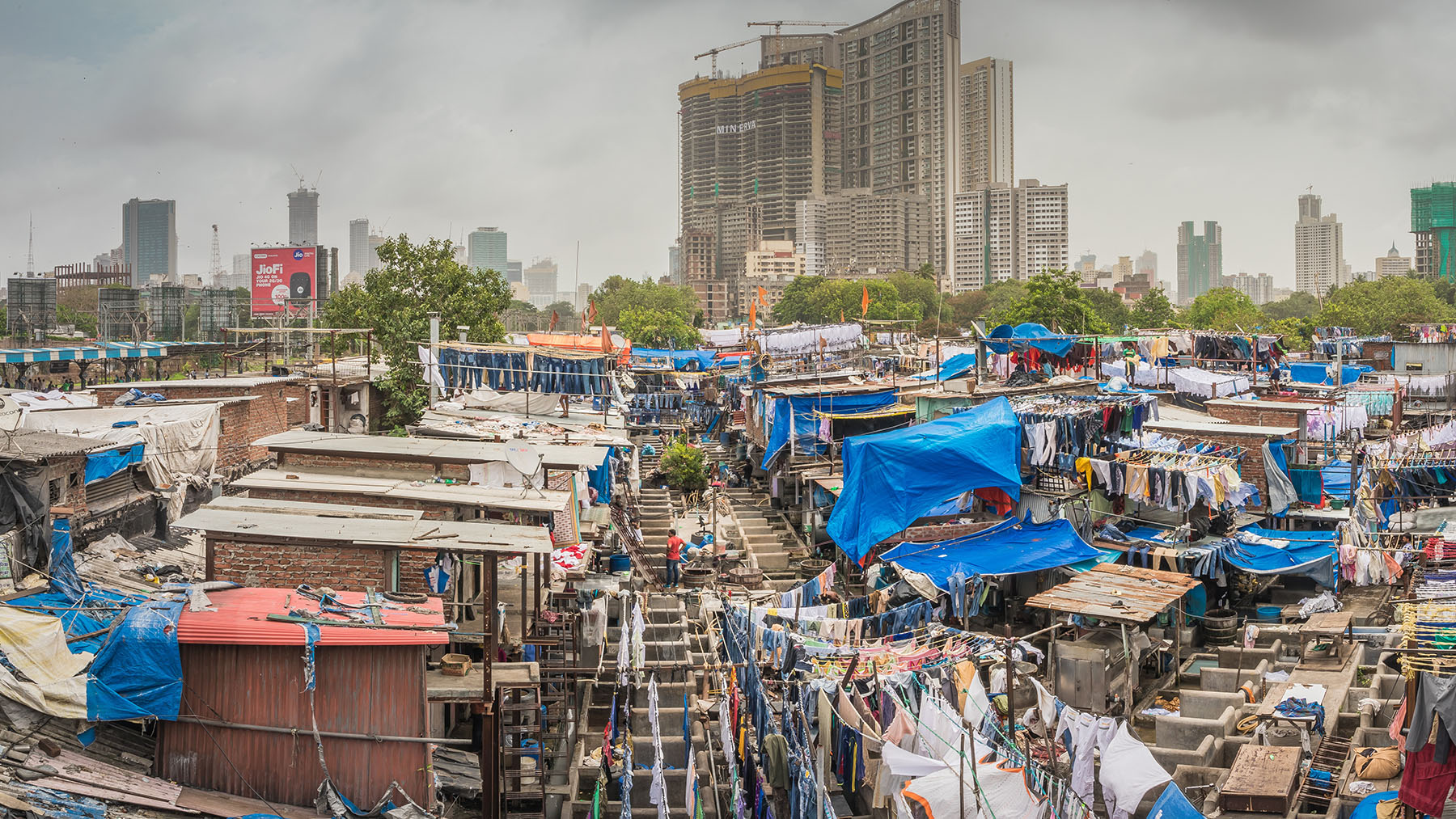 The Dhobi Ghat open-air laundry in the city of Mumbai. Cities and dense urban areas present particular health challenges, but also unique opportunities. (StevenK / Shutterstock.com)