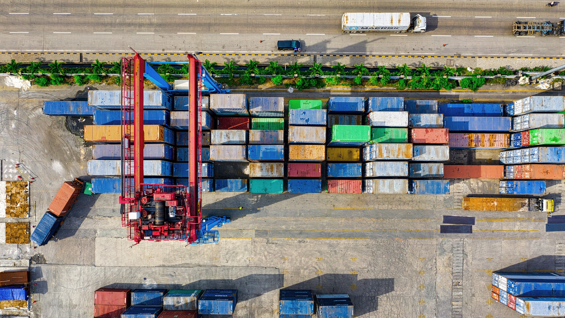 Shipping containers are staged for transport in Jakarta, Indonesia. Covid-19 has had sweeping impacts on the global supply chain, and psychologists who study human behavior are taking note. (Photo by Tom Fisk from Pexels)