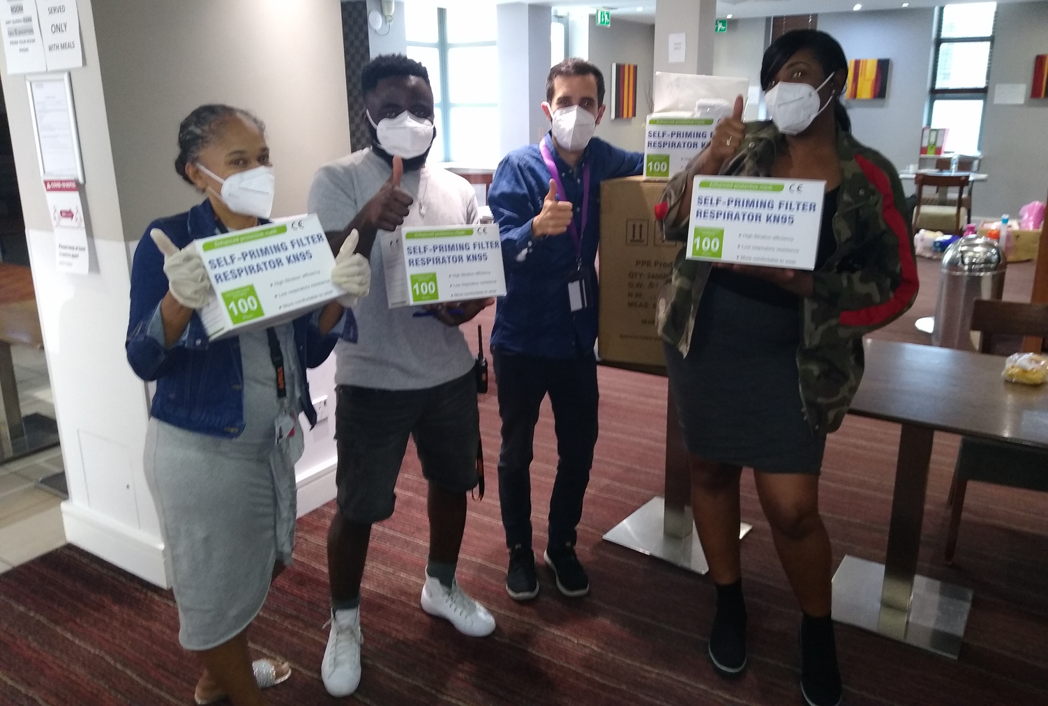 Staff members at an InterContinental Hotel in London with KN95 masks donated by Direct Relief. (Courtesy Photo via the Greater London Authority)