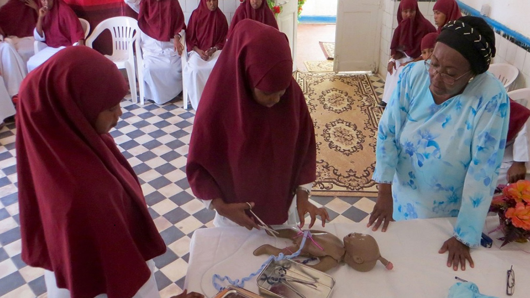 Edna Adan, founder of the Edna Adan University Hospital and a prominent women's health advocate, oversees a student midwife. (Photo courtesy of Edna Adan)