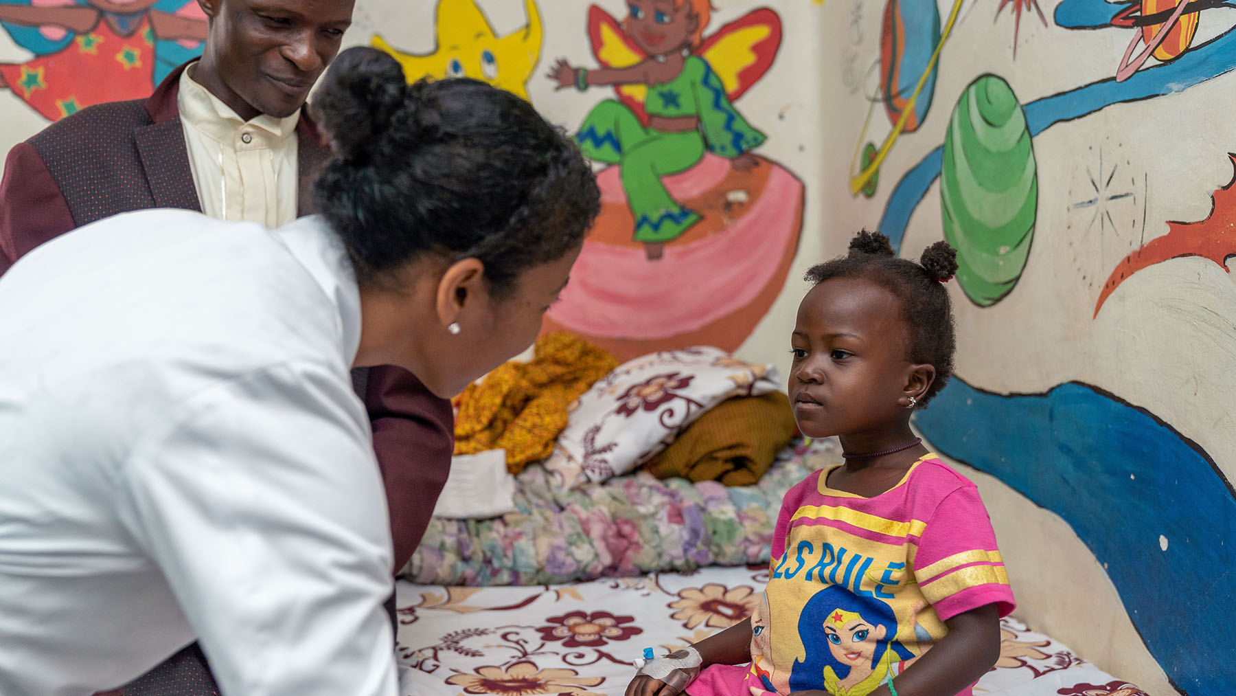A doctor talks to a child at Mulago National Referral Hospital in Uganda. (Photo courtesy of Texas Children's Hospital)