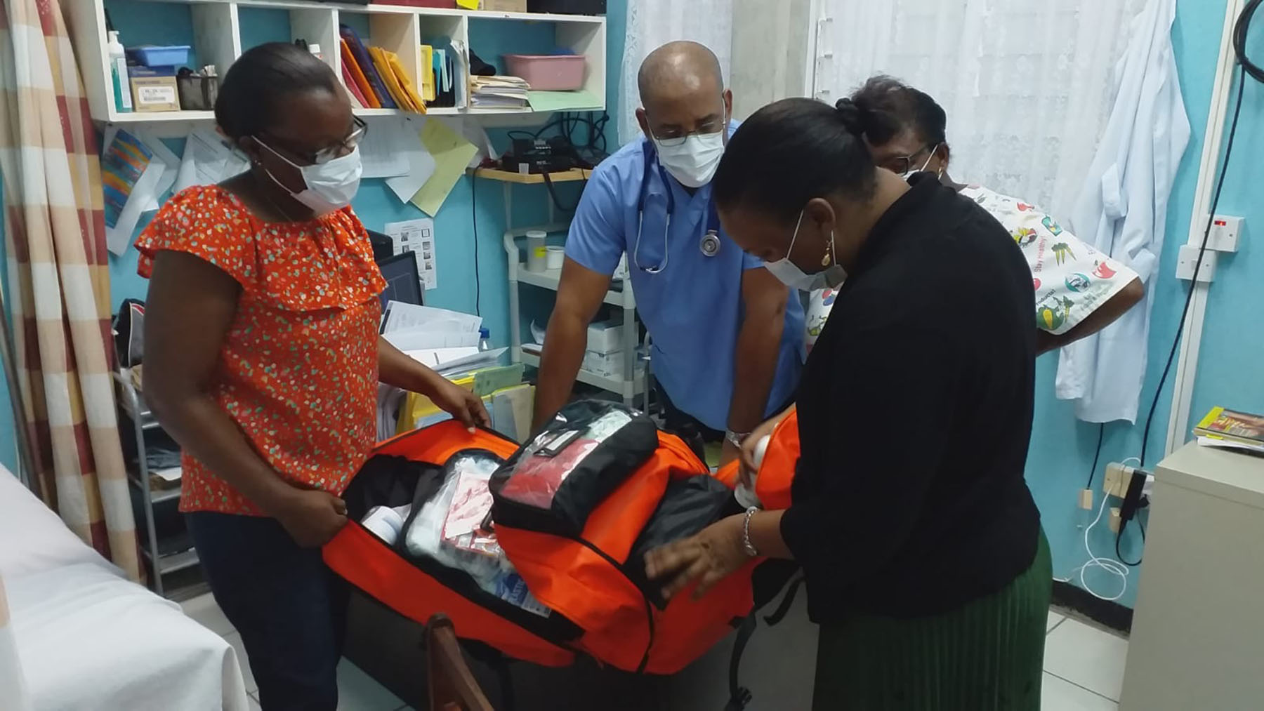 Healthcare professionals in Dominica unpack a cache of emergency medical supplies provided by Direct Relief. The Caribbean nation is bracing for an outbreak of coronavirus cases as the Atlantic hurricane season picks up. (Dr. Laura Espirit/Direct Relief)