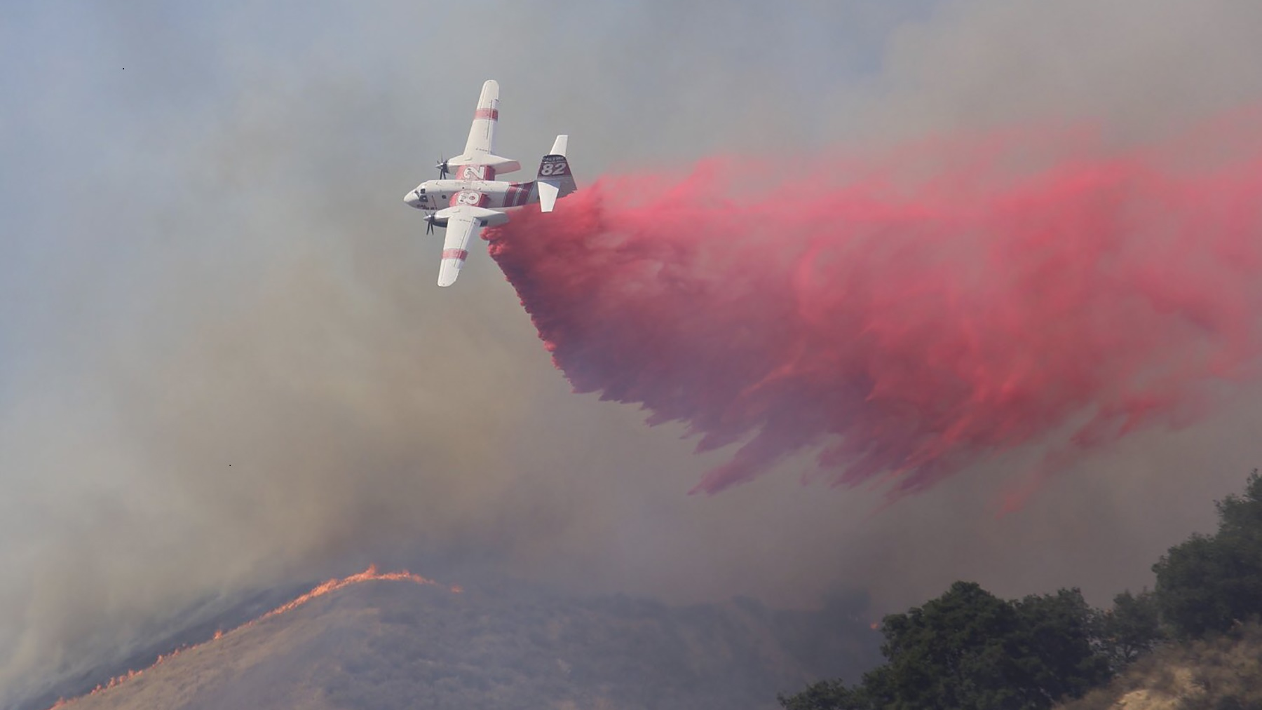 A CALFire air tanker drops fire retardant on the Crews Fire east of Gilroy, California, on July 5, 2020. (Photo by Jaden Schaul)