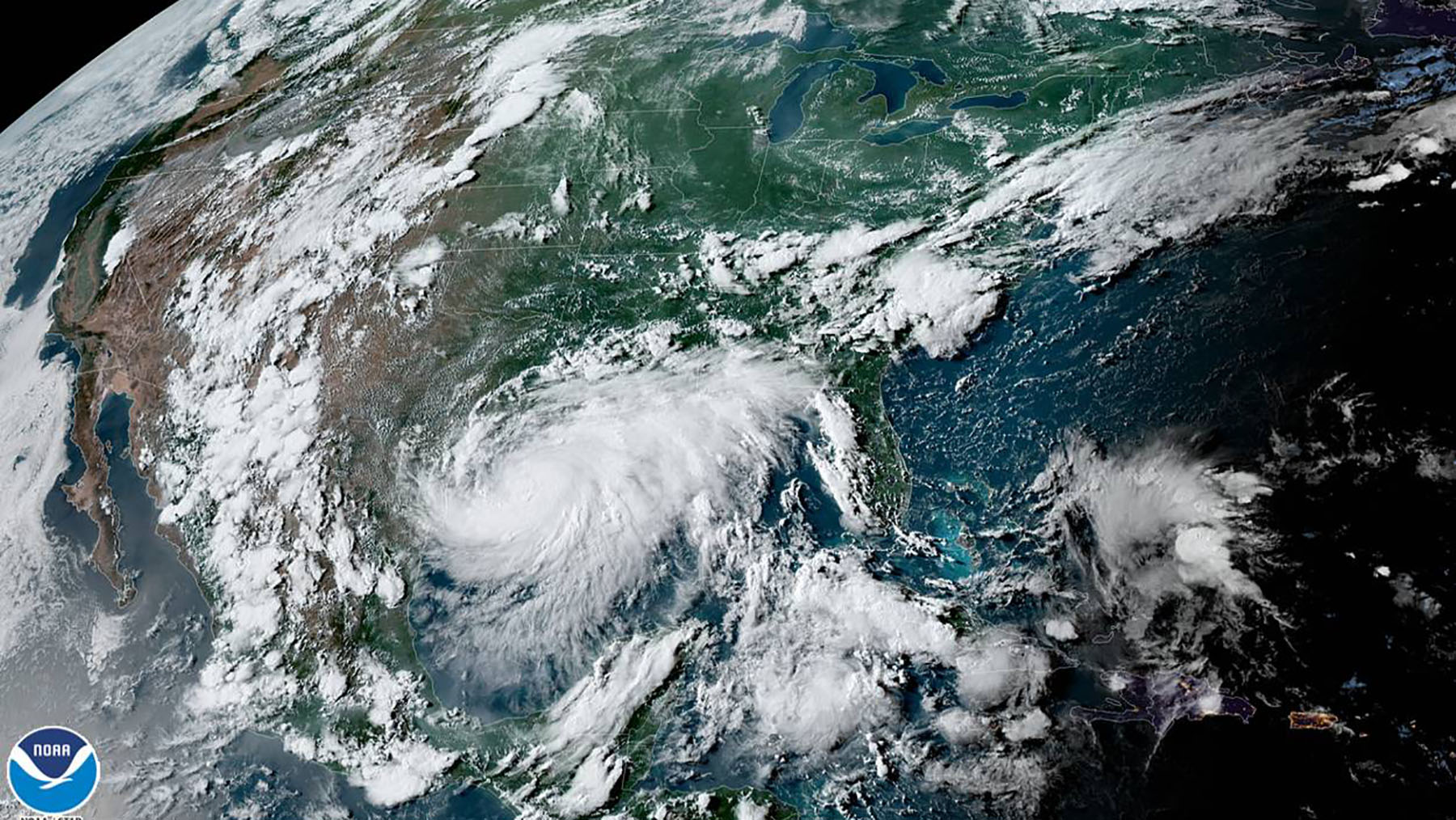 Tropical Storm Hanna, pictured left, is barreling towards the Texas coast, while Tropical Storm Gonzalo continues its path through the Caribbean. (NOAA photo)