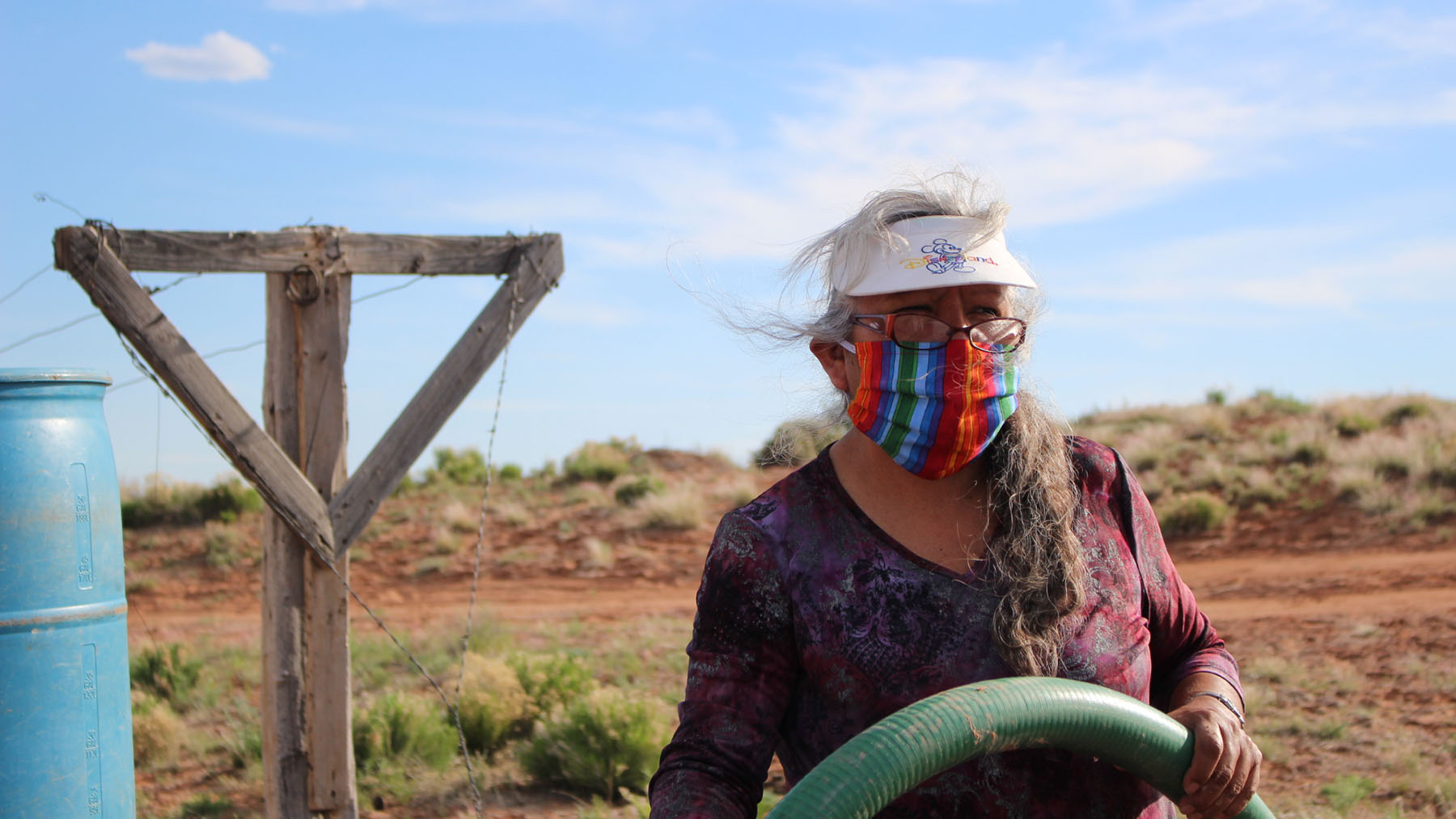 Navajo Nation resident Verna Martinez pumps water for fellow community members in April, 2020.  Infrastructure challenges exist for many parts of the nation, but health providers are working to ensure access to care.(Photo by Jonathan Schell for Direct Relief)