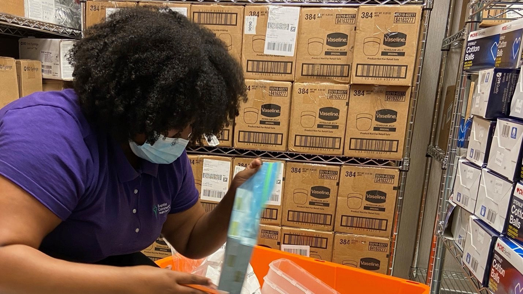 "A staff member at Baptist Community Health Services prepares ""go bags"" for health care providers in preparation for Hurricane Laura's landfall. (Photo courtesy of Baptist Community Health Services)"