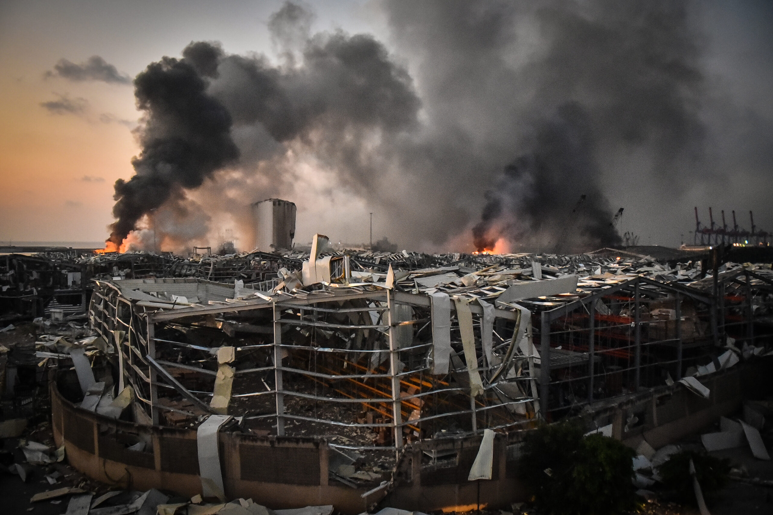 Smoke rises from the port after the explosion on August 4, 2020 in Beirut, Lebanon. According to the Lebanese Red Cross, at the moment over 100 people died in the explosion and over 4,000 were injured in explosion at Beirut Port. Officials said a waterfront warehouse storing explosive materials, reportedly 2,700 tons of ammonium nitrate, was the cause of the blast.(Photo by Fadel Itani/NurPhoto via Getty Images)